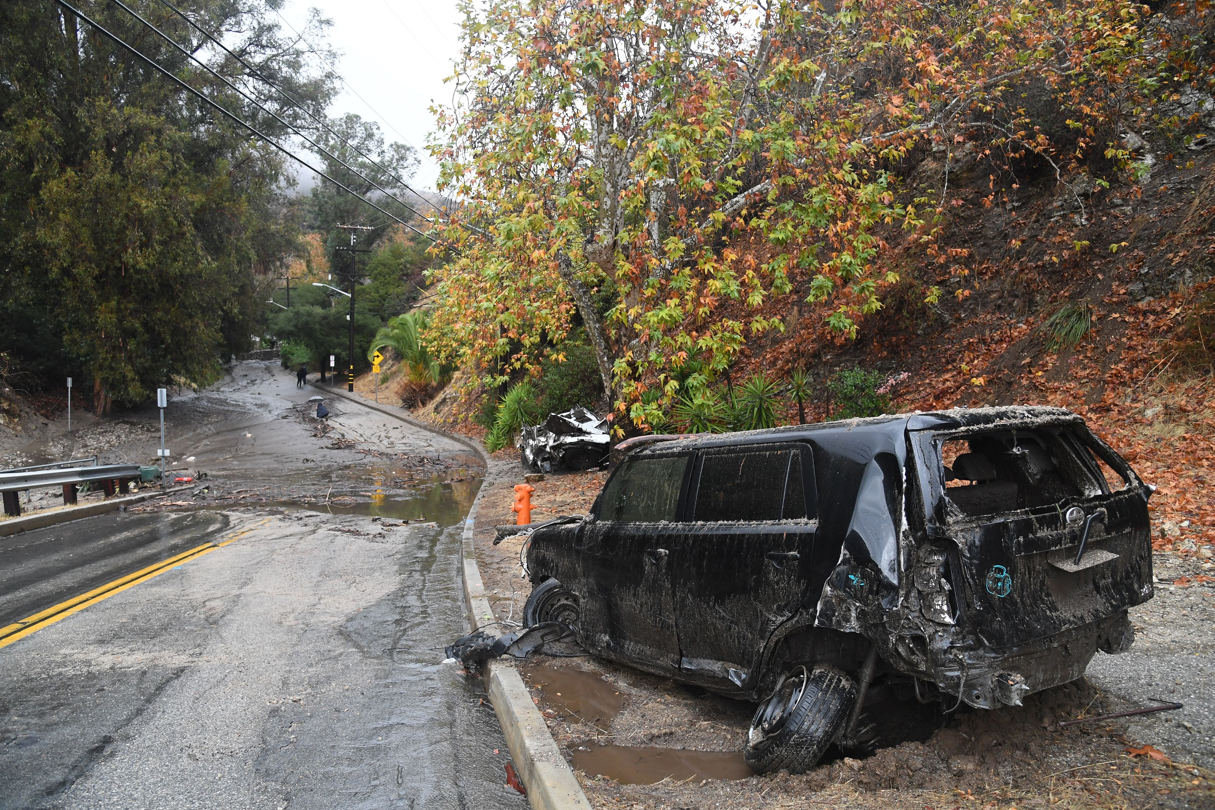 Two cars washed downhill in a rain-driven mudslide are seen in a neighborhood under mandatory evacuation in Burbank, California, January 9, 2018. Mudslides unleashed by a ferocious storm demolished homes in southern California, authorities said Tuesday.