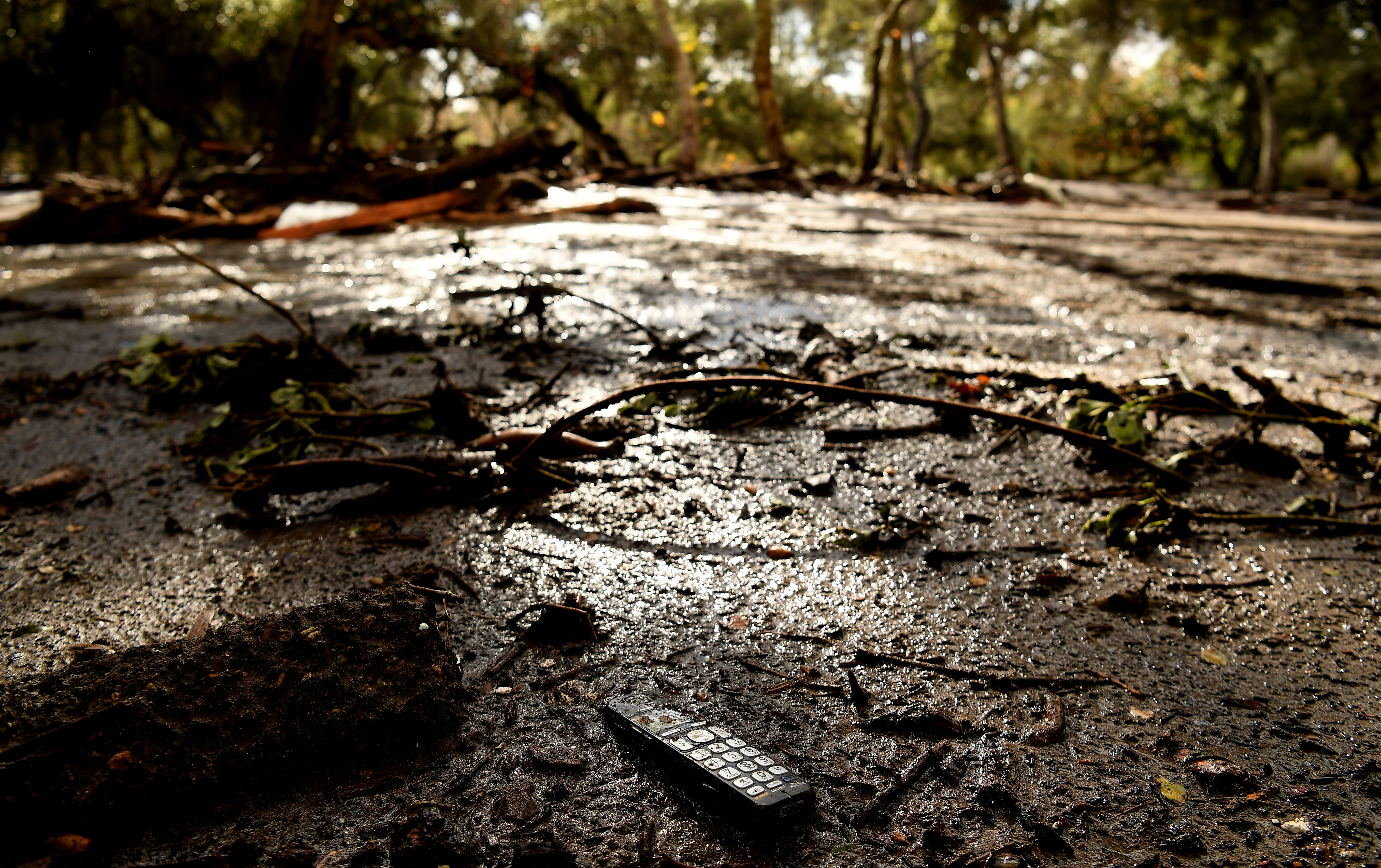 A remote sits in the mud along along Olive Mill Road in Montecito after a major storm hit the burn area January 9, 2018 in Montecito, California.