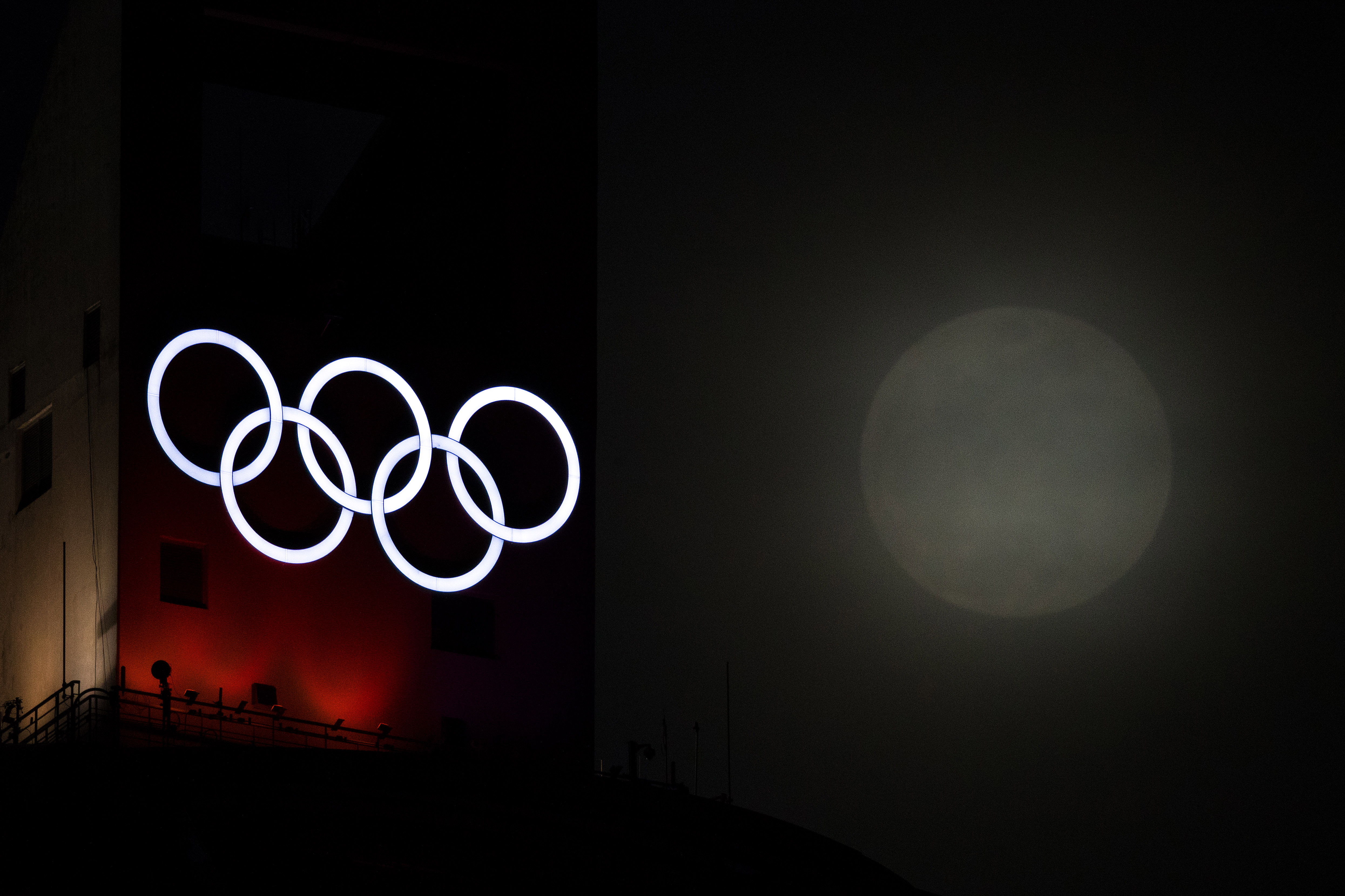 A Super Moon rises through the clouds past the Olympic Rings ahead of the Pyeongchang 2018 Winter Olympics on January 31, 2018 in Pyeongchang-gun, South Korea.