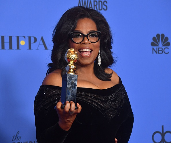 Oprah Winfrey poses with the Cecil B. DeMille Award during the 75th Golden Globe Awards on January 7, 2018, in Beverly Hills, California.