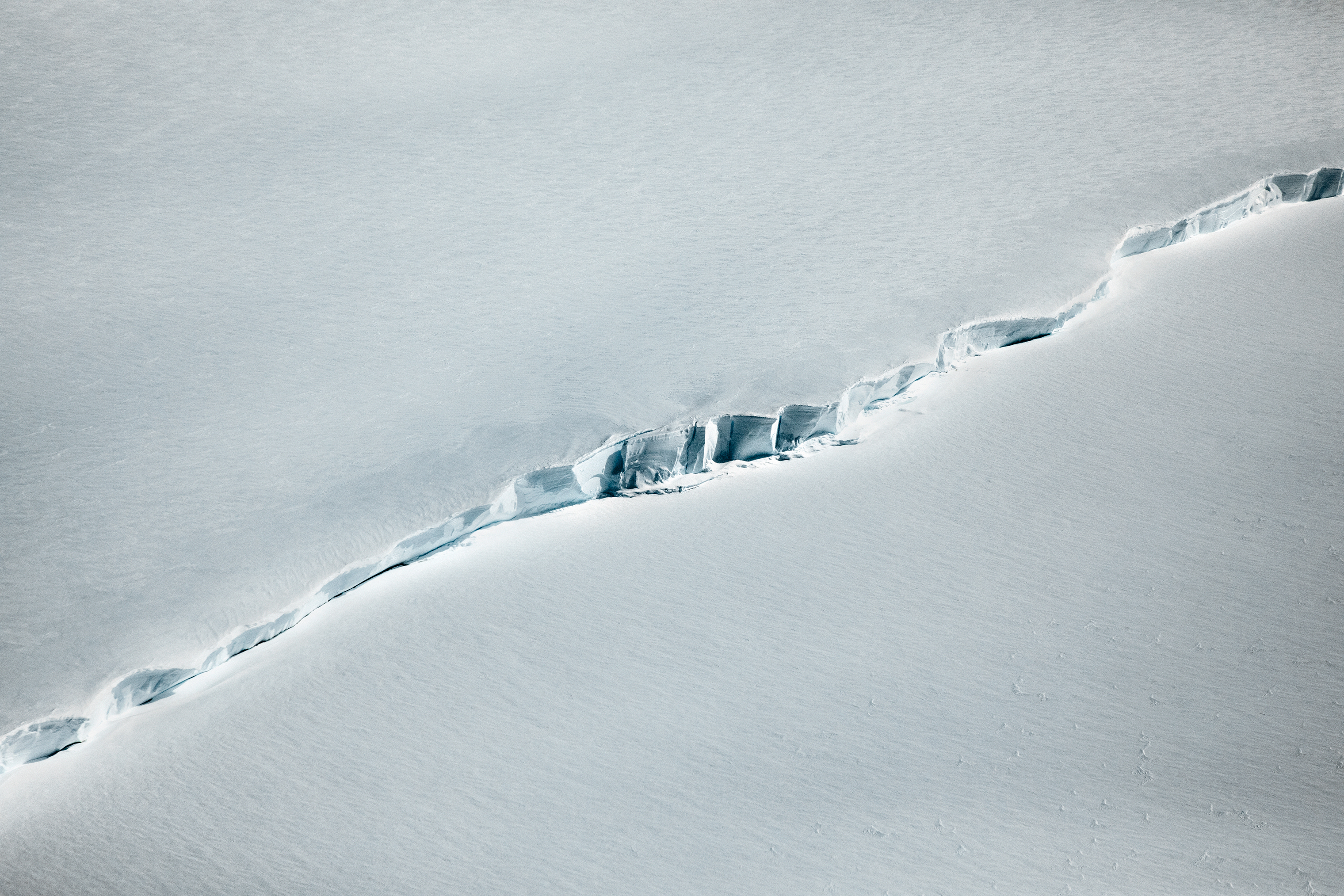 A crevasse measuring a few thousand feet fills the photographer's frame from an altitude of 1,500 ft., during a November flyover.