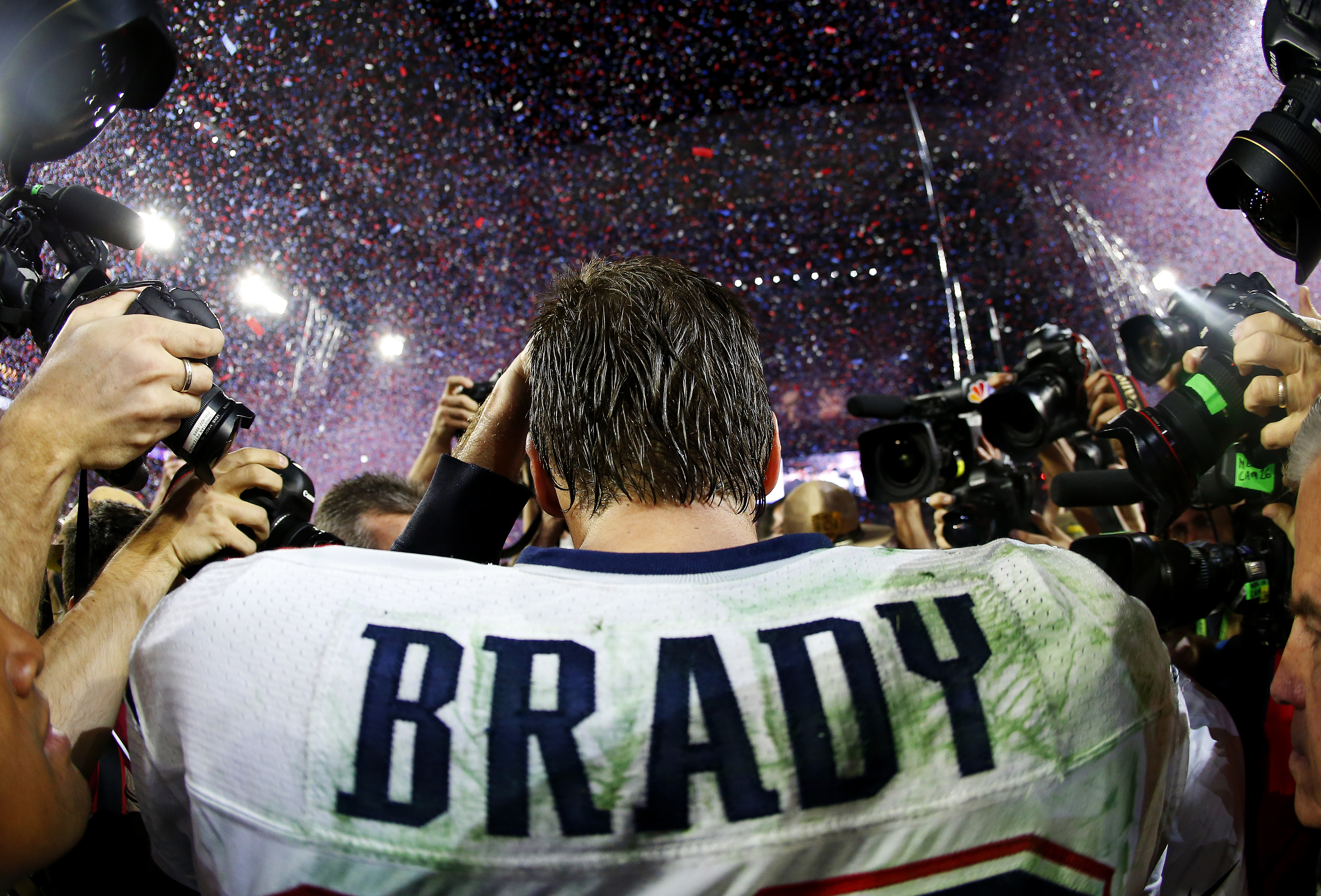 Tom Brady #12 of the New England Patriots is surrounded by the media after defeating the Seattle Seahawks 28-24 during Super Bowl XLIX at University of Phoenix Stadium on February 1, 2015 in Glendale, Arizona.