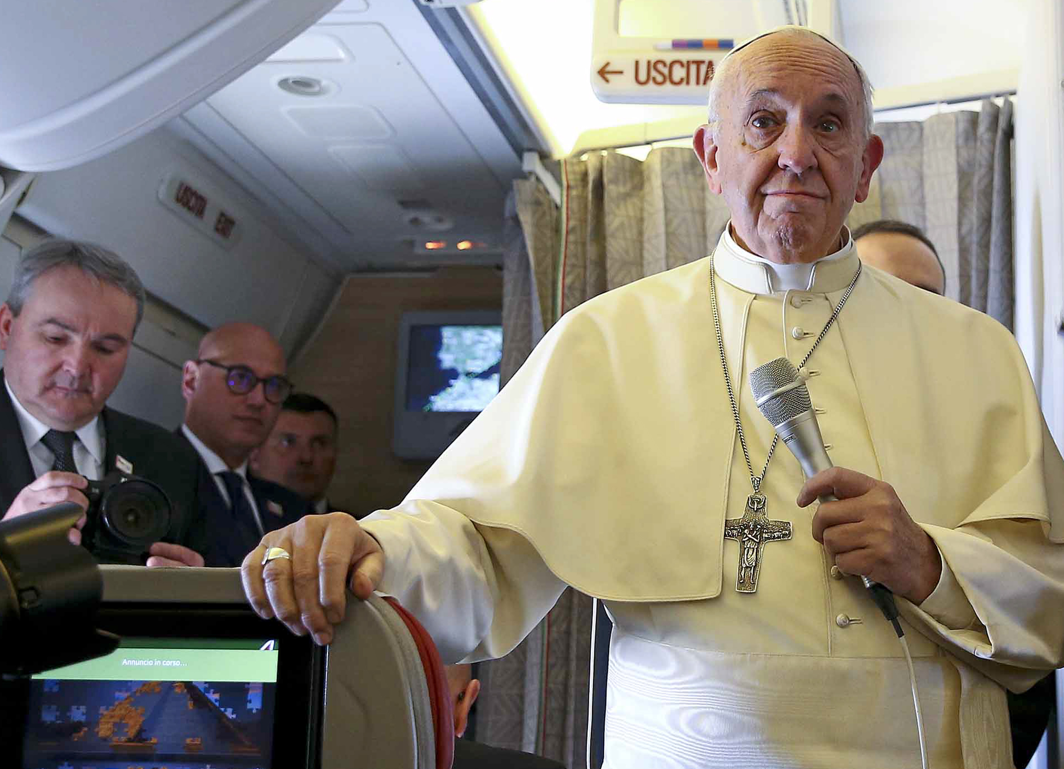 Pope Francis addresses journalists aboard the plane for his trip to Chile and Peru, on January 15, 2018.