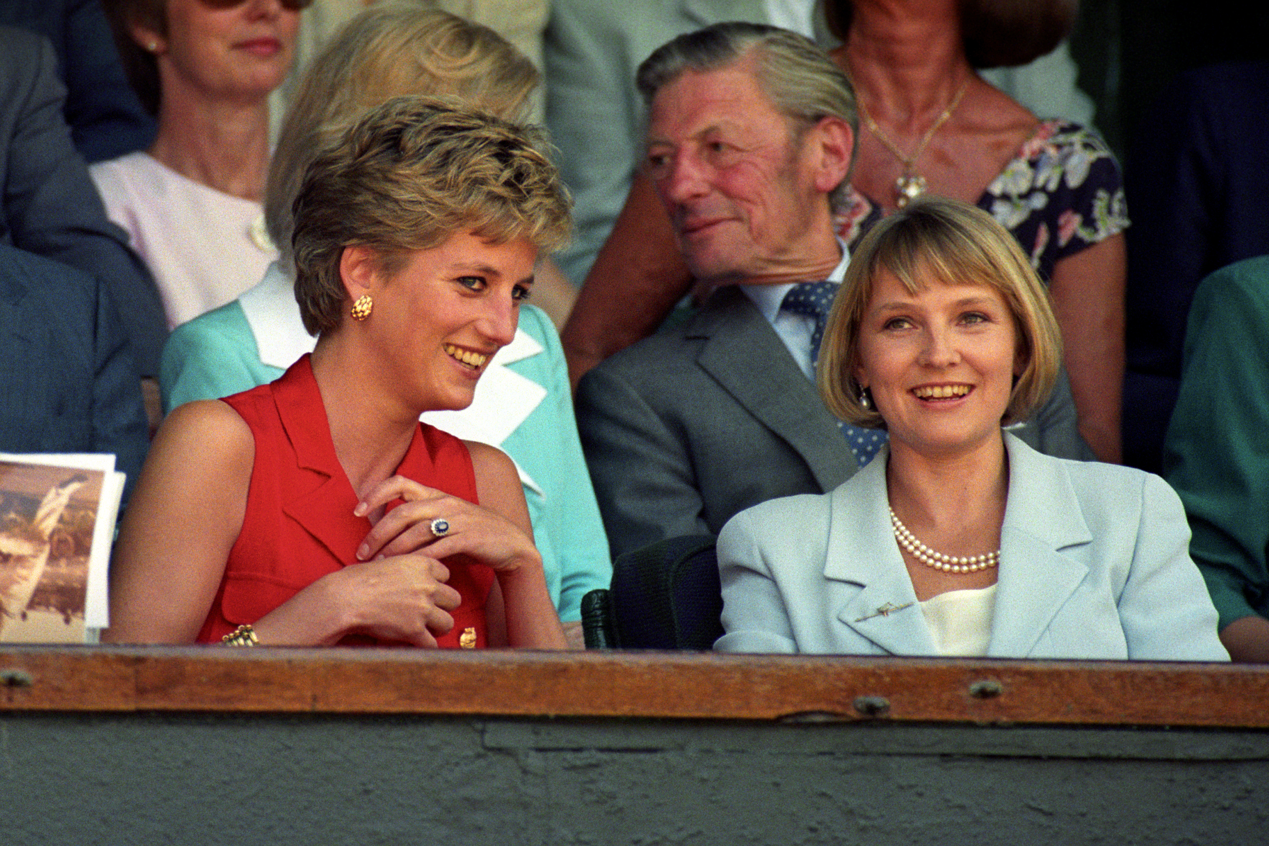 Princess of Wales chats with Mrs Julia Samuel in the royal box on centre court before the men's singles final between Pete Sampras and Goran Ivanisevic.