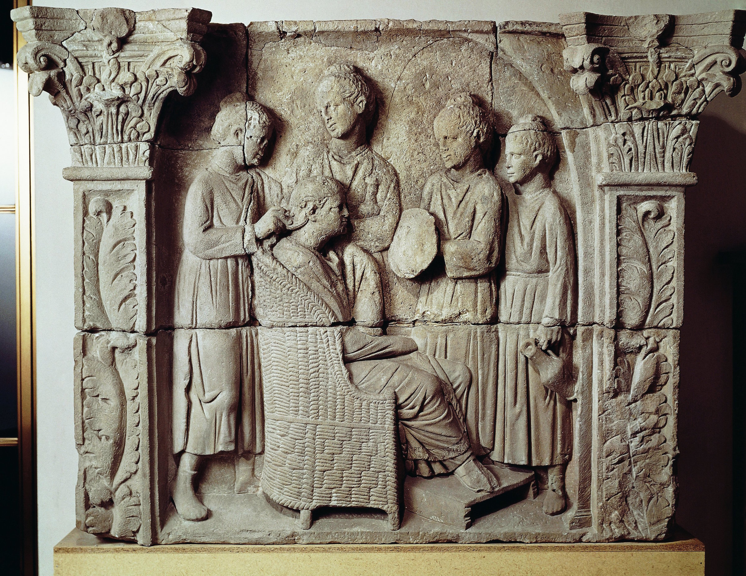 Second century A.D. Roman relief portraying a lady having her hair styled. From Neumagen-Dhron, Germany.
