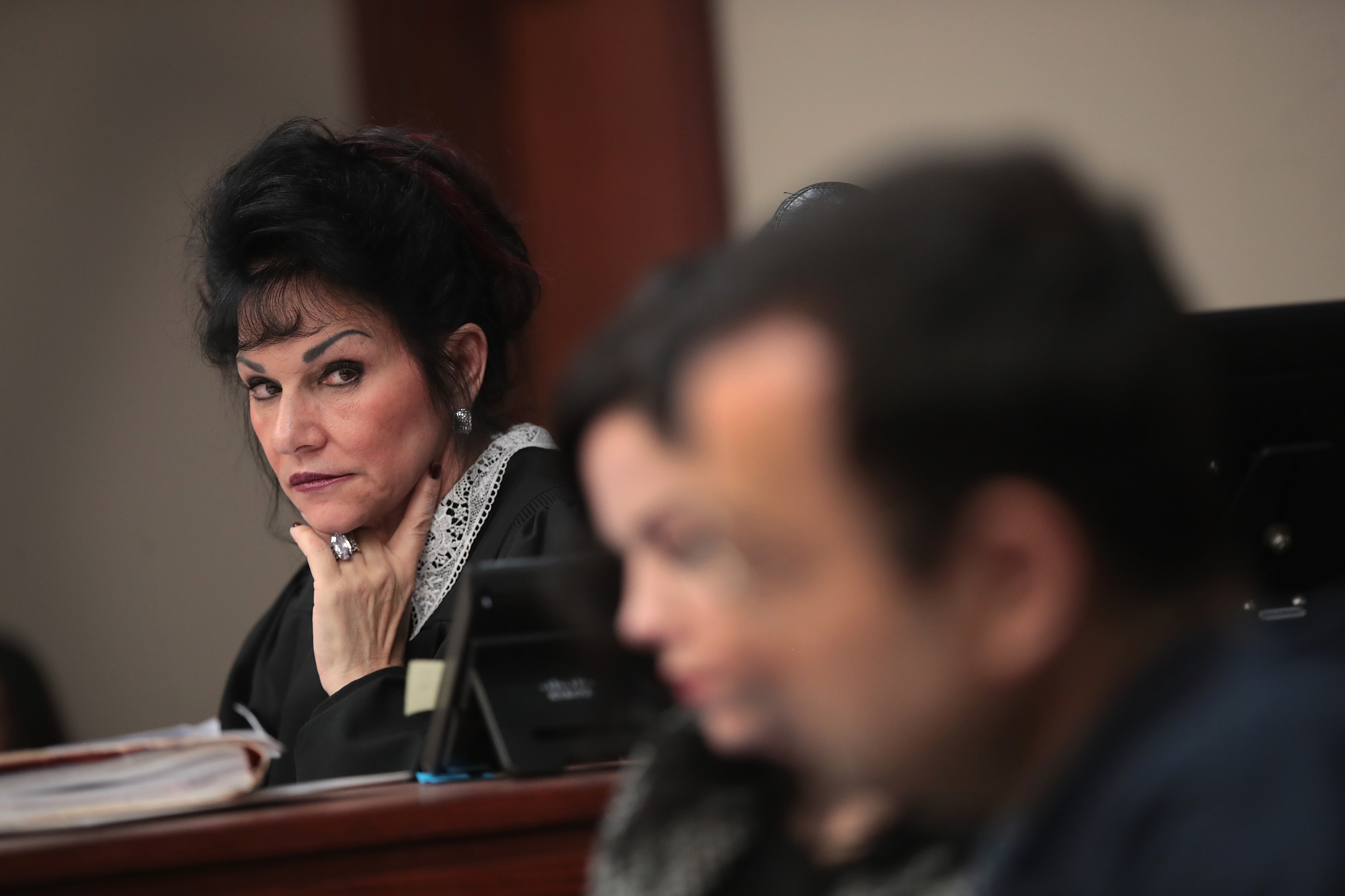 Judge Rosemarie Aquilina (L) looks at Larry Nassar (R) as he listens to a victim's impact statement by Jennifer Rood Bedford prior to being sentenced Wednesday. Photo by Scott Olson/Getty Images