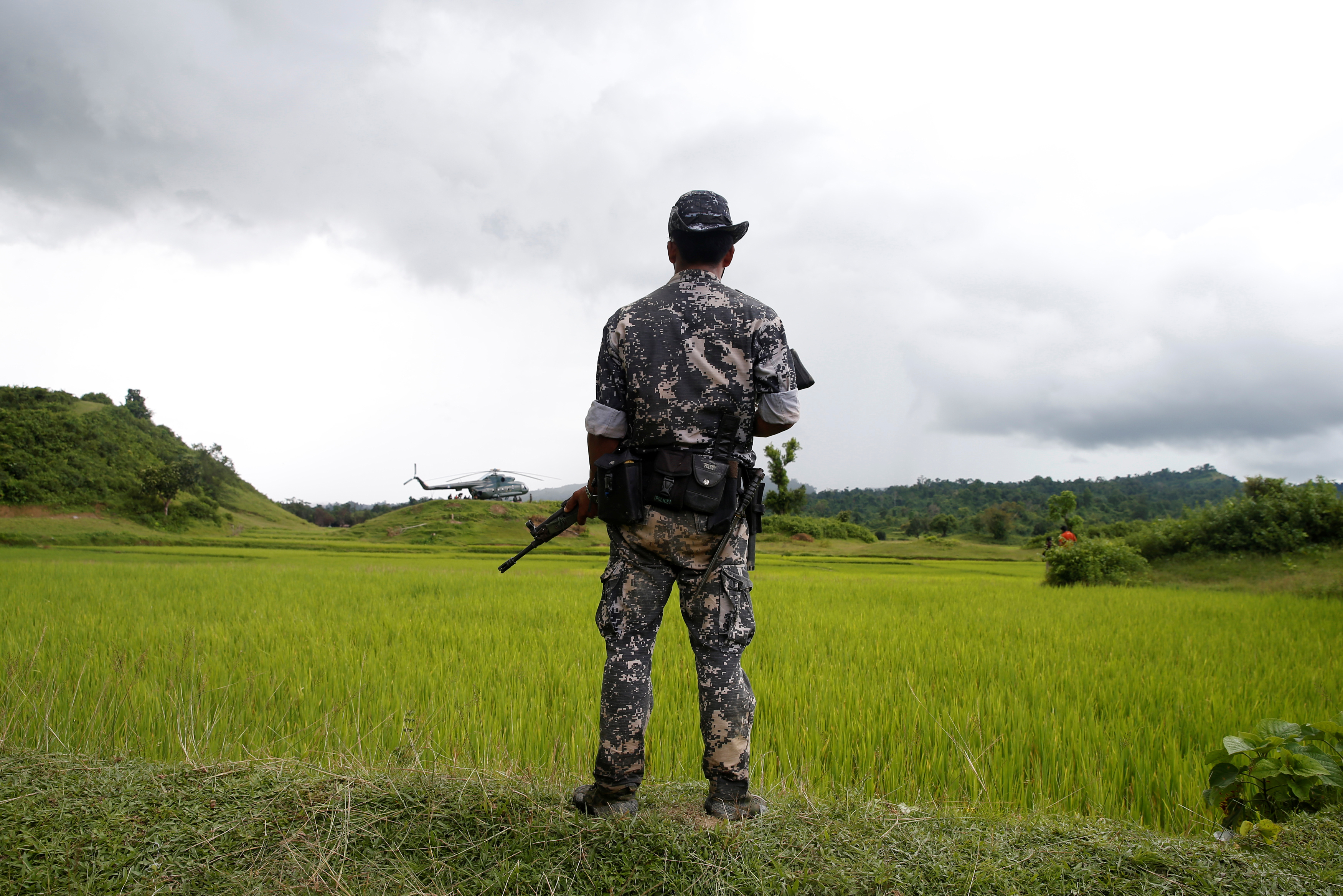 A Myanmar soldier stands near Maungdaw in northern Rakhine state, Myanmar on Sept. 27, 2017.