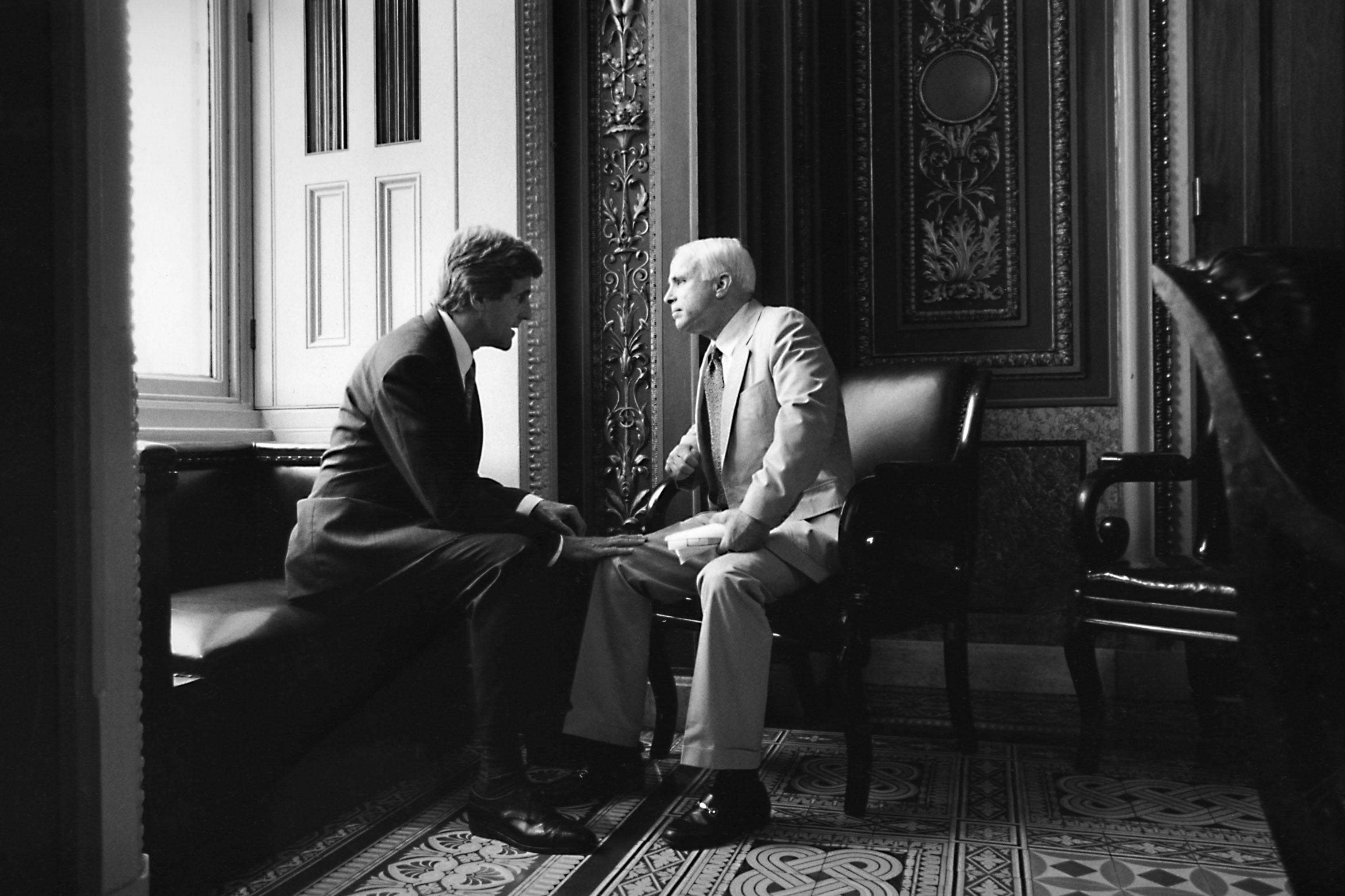 Sen. John Kerry chats with Sen. John McCain in Washington in 1997.