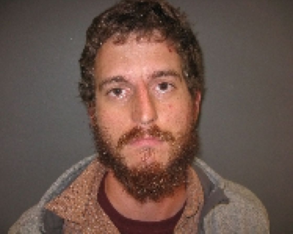 This booking photo provided by Furnas County Sheriff's Office shows Taylor Wilson, a white supremacist accused of stopping an Amtrak train in Nebraska. Documents unsealed Wednesday in U.S. District Court in Lincoln, Neb., show the 26-year-old Wilson, of St. Charles, Mo., is charged with terrorism attacks and other violence against railroad carriers and mass transportation systems.