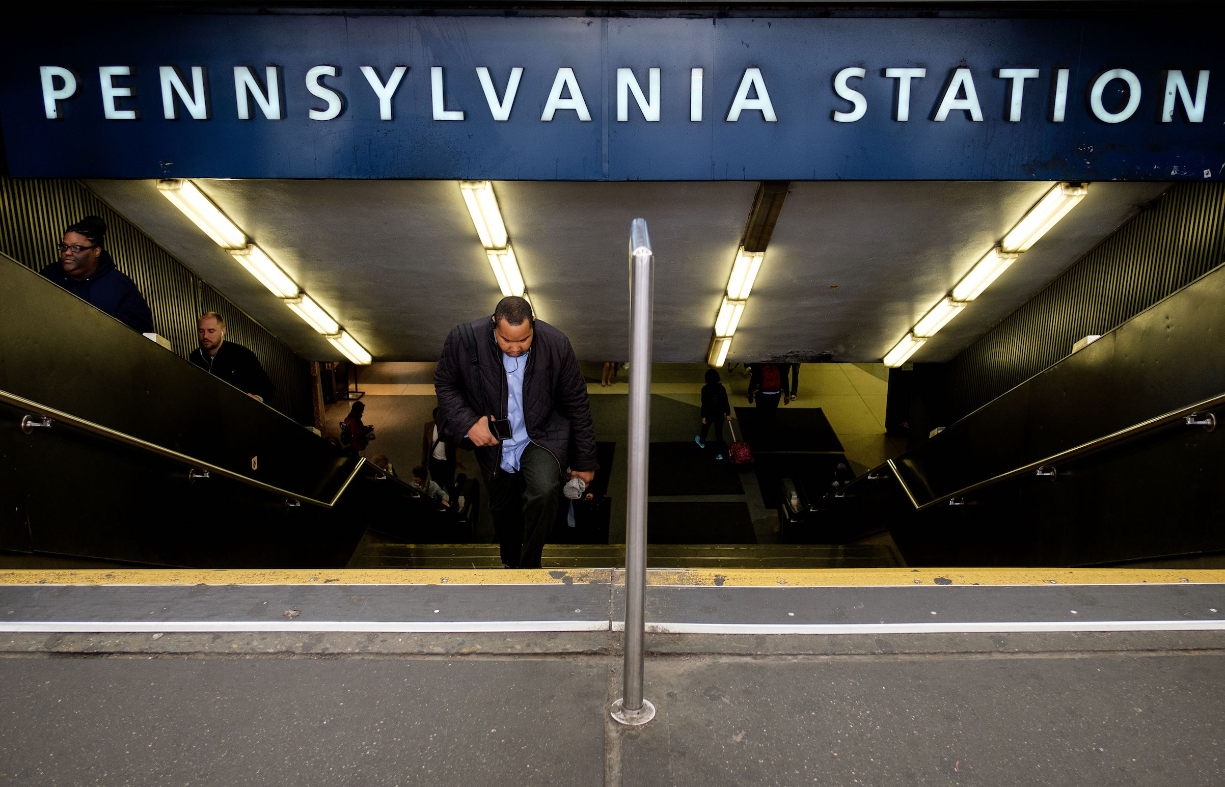 Travelers exit Pennsylvania Station, May 31, 2017 in New York City.