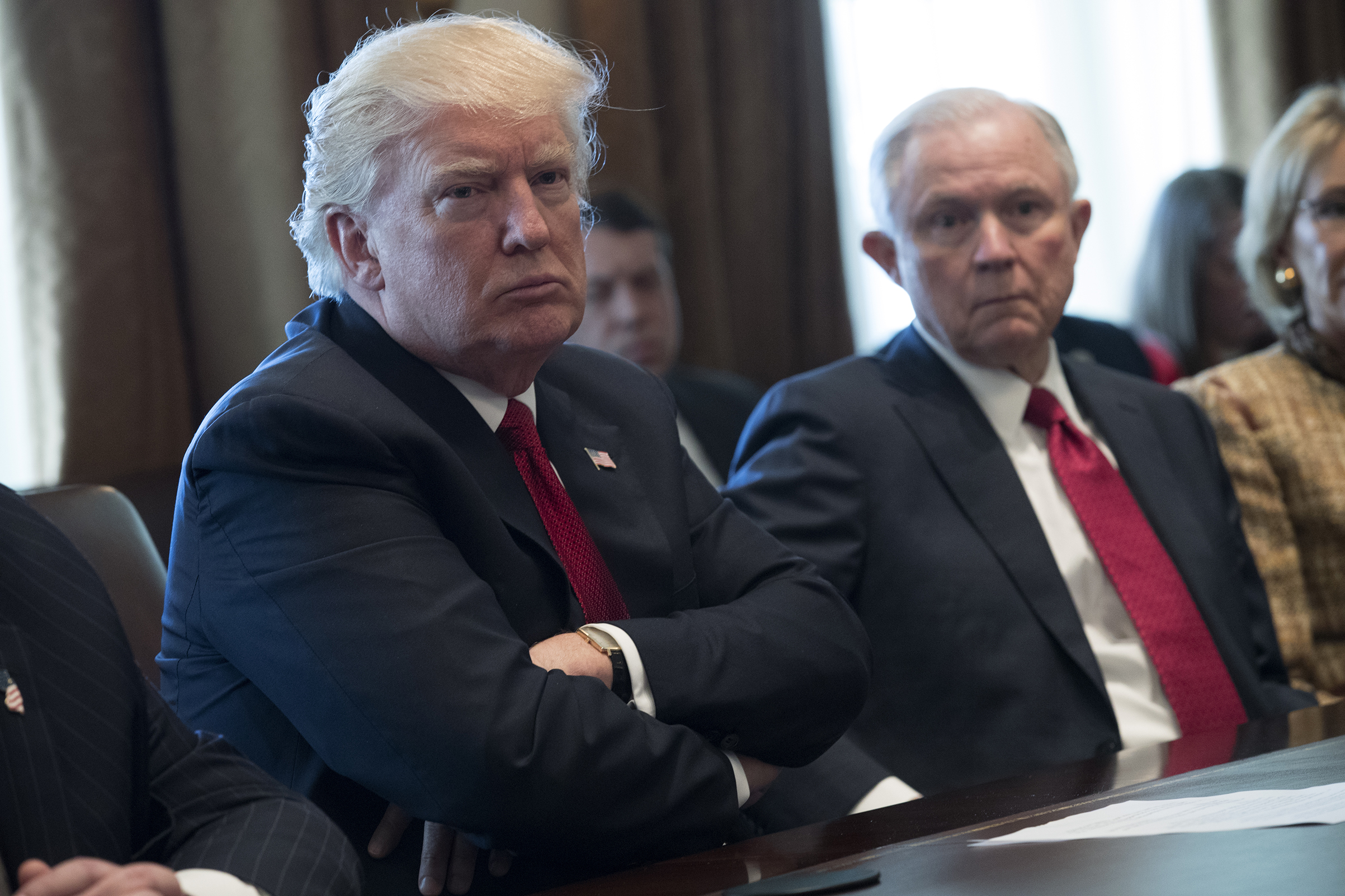 U.S. President Donald Trump (L) and Attorney General Jeff Sessions (R) attend a panel discussion on an opioid and drug abuse in the Roosevelt Room of the White House March 29, 2017 in Washington, DC.