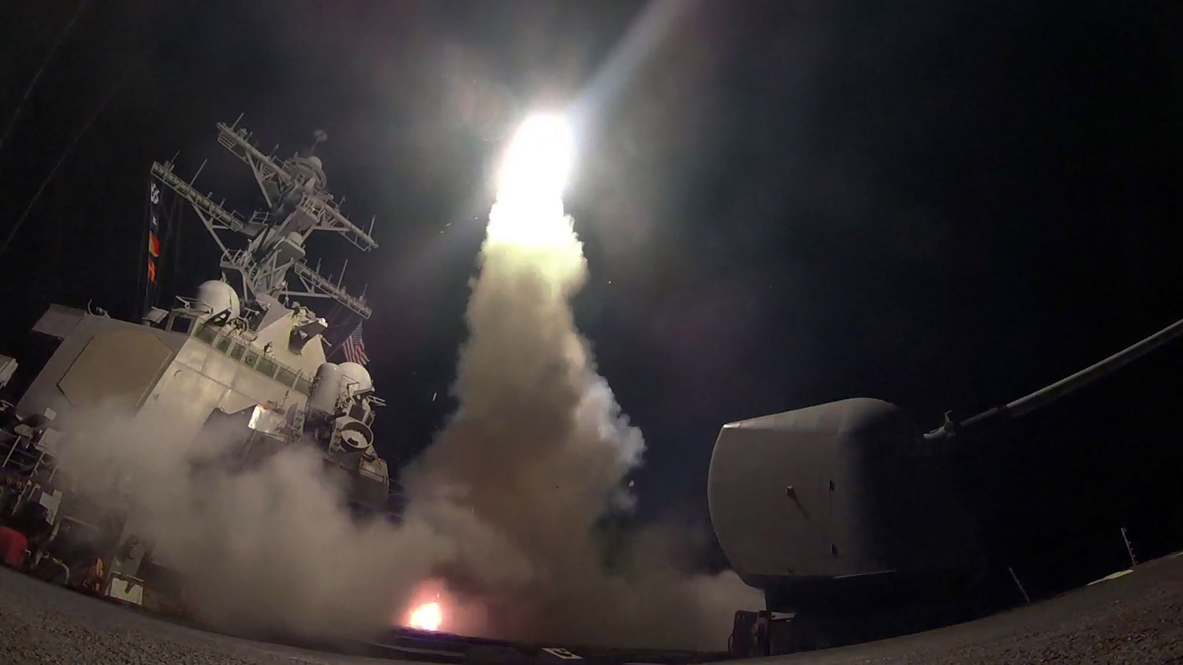 The guided-missile destroyer USS Porter launches a tomahawk land attack missile as the United States blasted a Syrian air base.