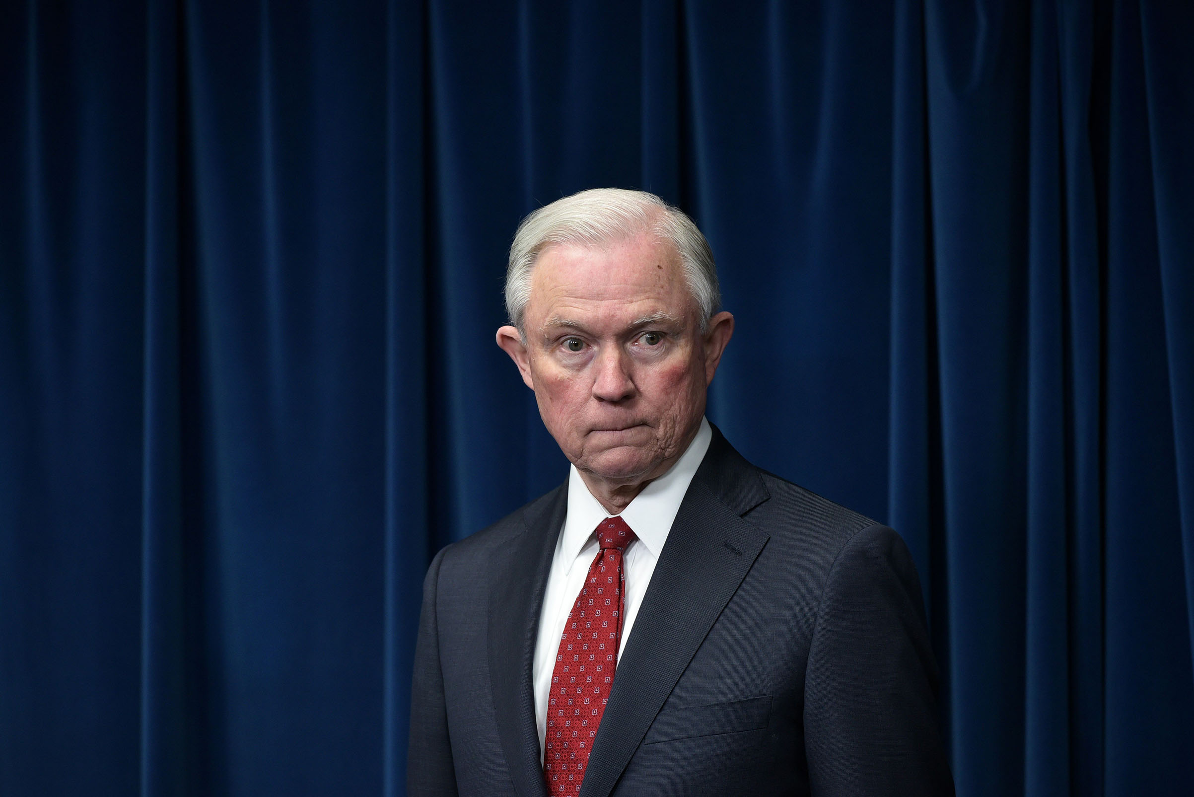 Attorney General Jeff Sessions waits for his turn to speak at the US Customs and Border Protection Press Room on March 6, 2017.