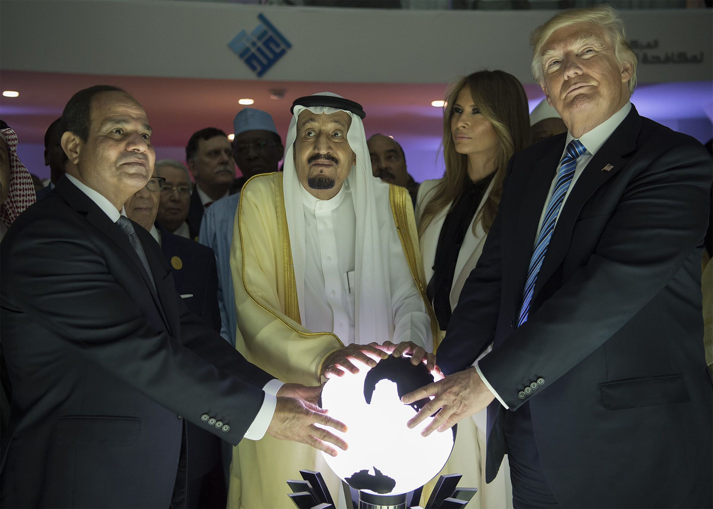 President Donald Trump, Melania Trump, Saudi Arabia's King Salman bin Abdulaziz al-Saud and Egyptian President Abdel Fattah el-Sisi put their hands on an illuminated globe during the inauguration ceremony of the Global Center for Combating Extremist Ideology on May 21, 2017.