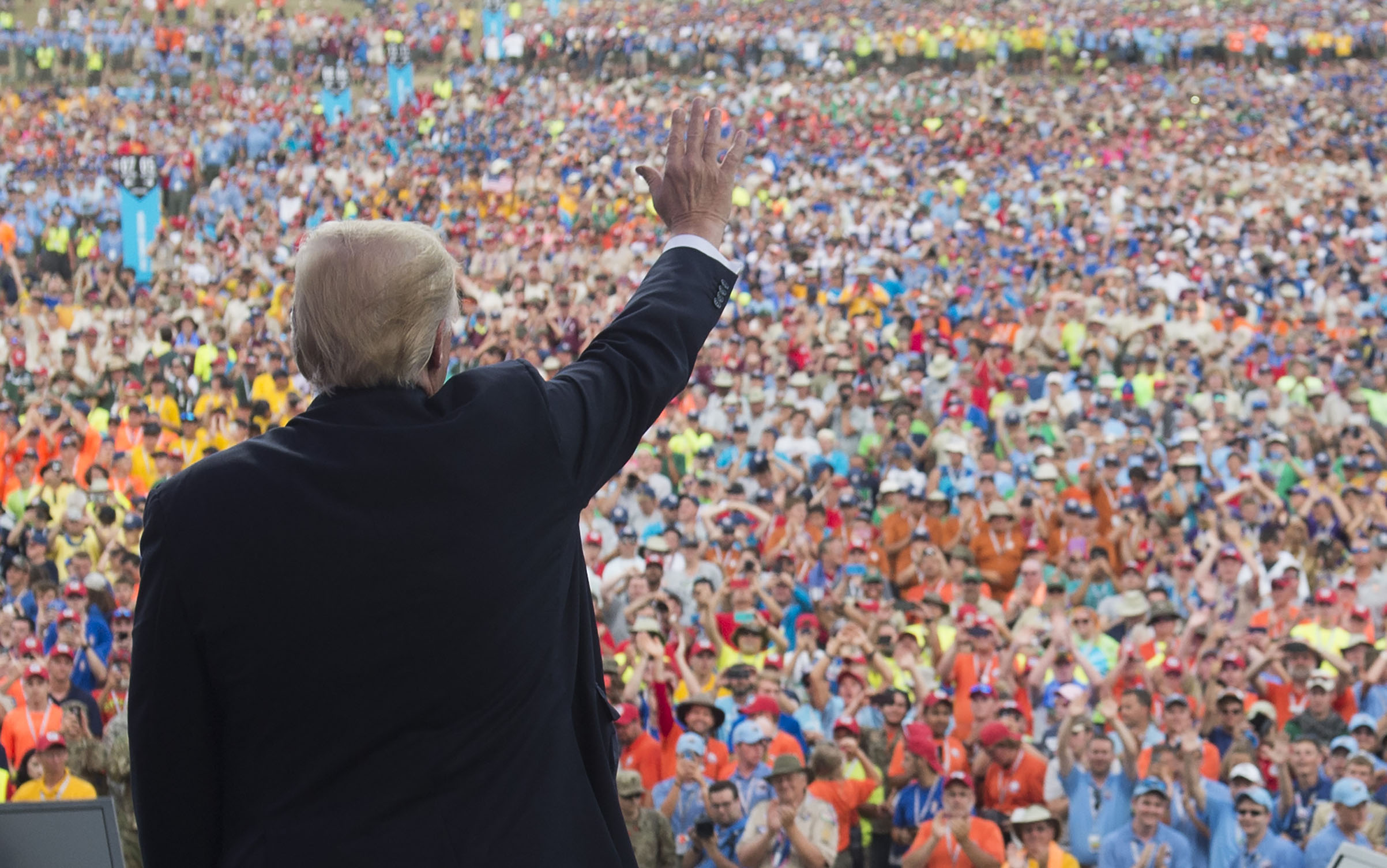 President Donald Trump waves after speaking to Boy Scouts during the National Boy Scout Jamboree on July 24, 2017.