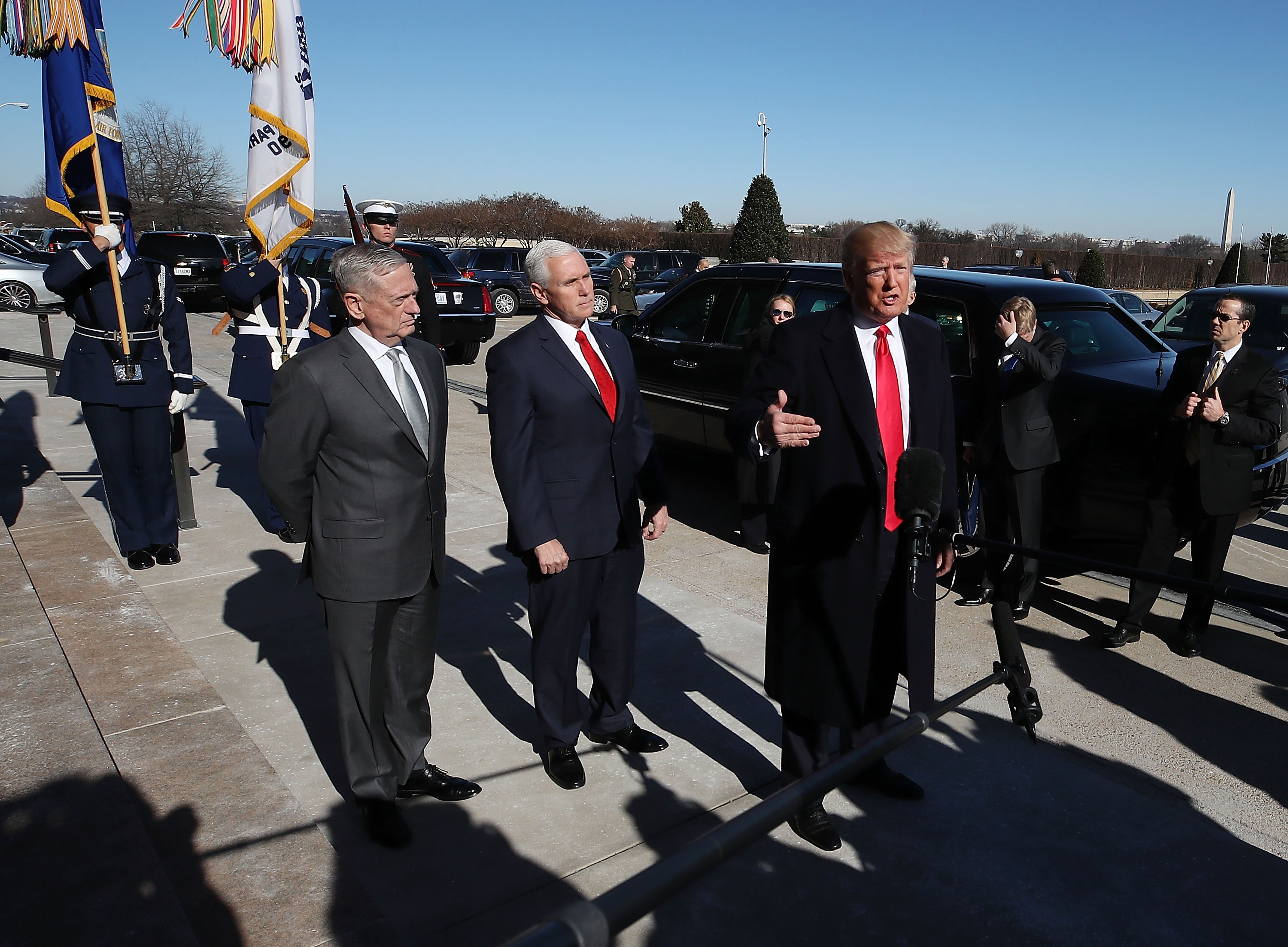 U.S. President Donald Trump speaks to the media after arriving for a meeting at the Pentagon, on January 18, 2018 in Arlington, Virginia. Also pictured are Vice President Mike Pence (C), and Defense Secretary Jim Mattis (L).