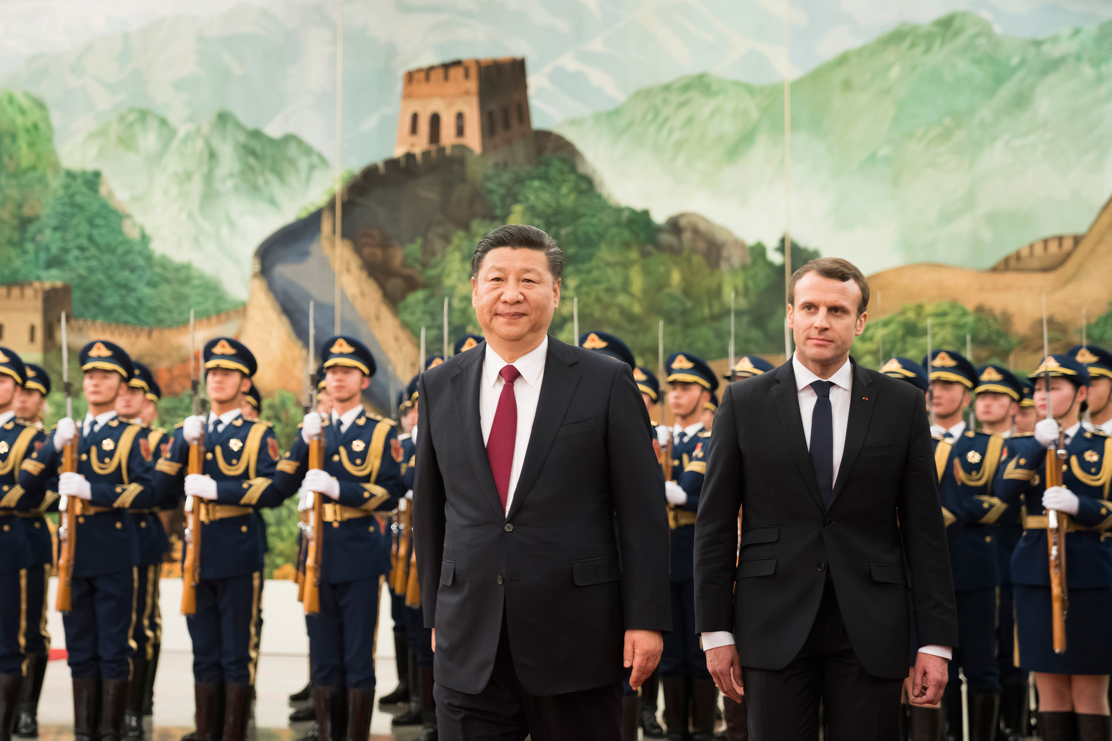 Chinese President Xi Jinping accompanies French President Emmanuel Macron to view an honour guard during a welcoming ceremony inside the Great Hall of the People on January 9, 2018 in Beijing, China.