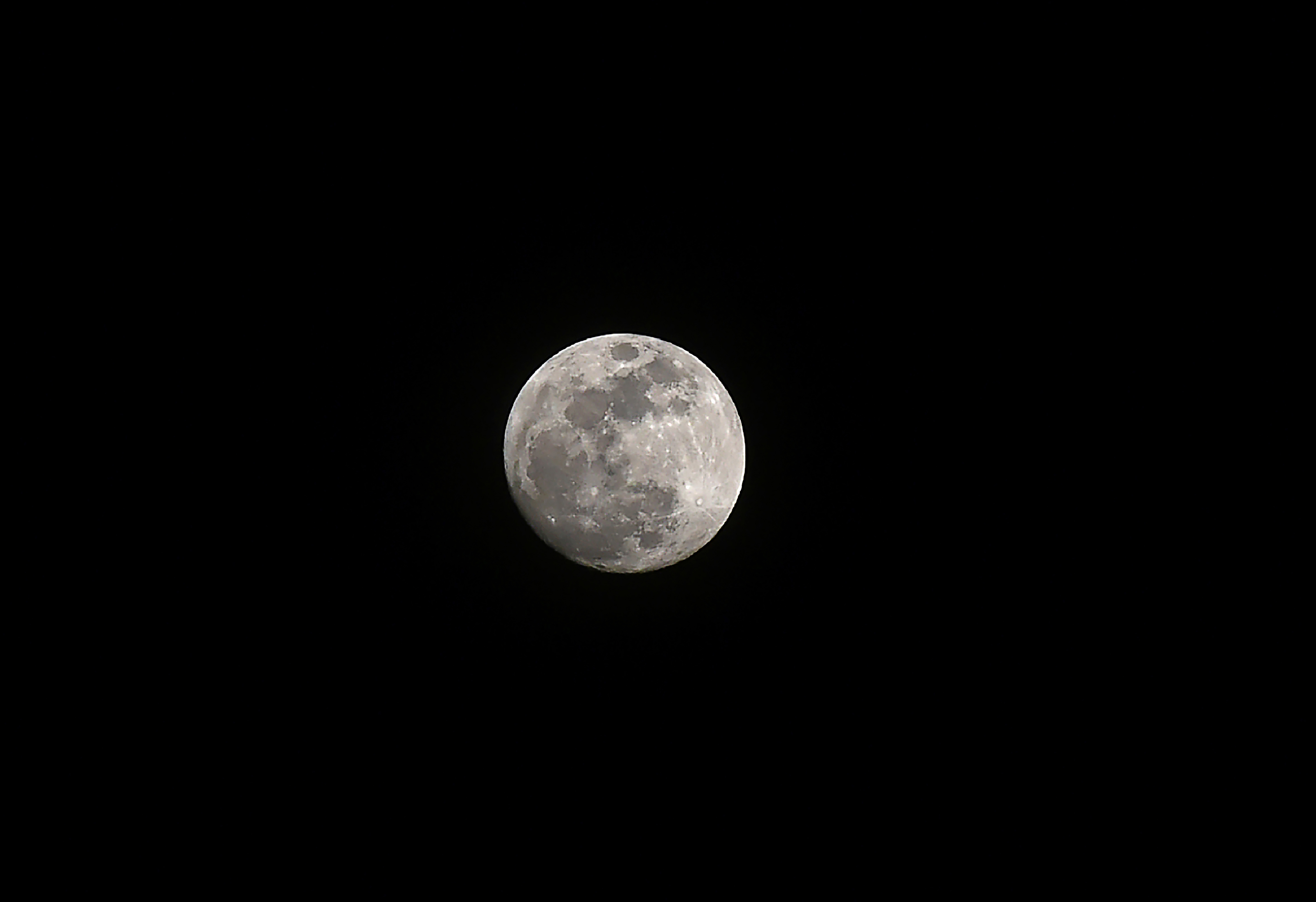 A  super moon  rise in the sky of Srinagar on January 30, 2018.