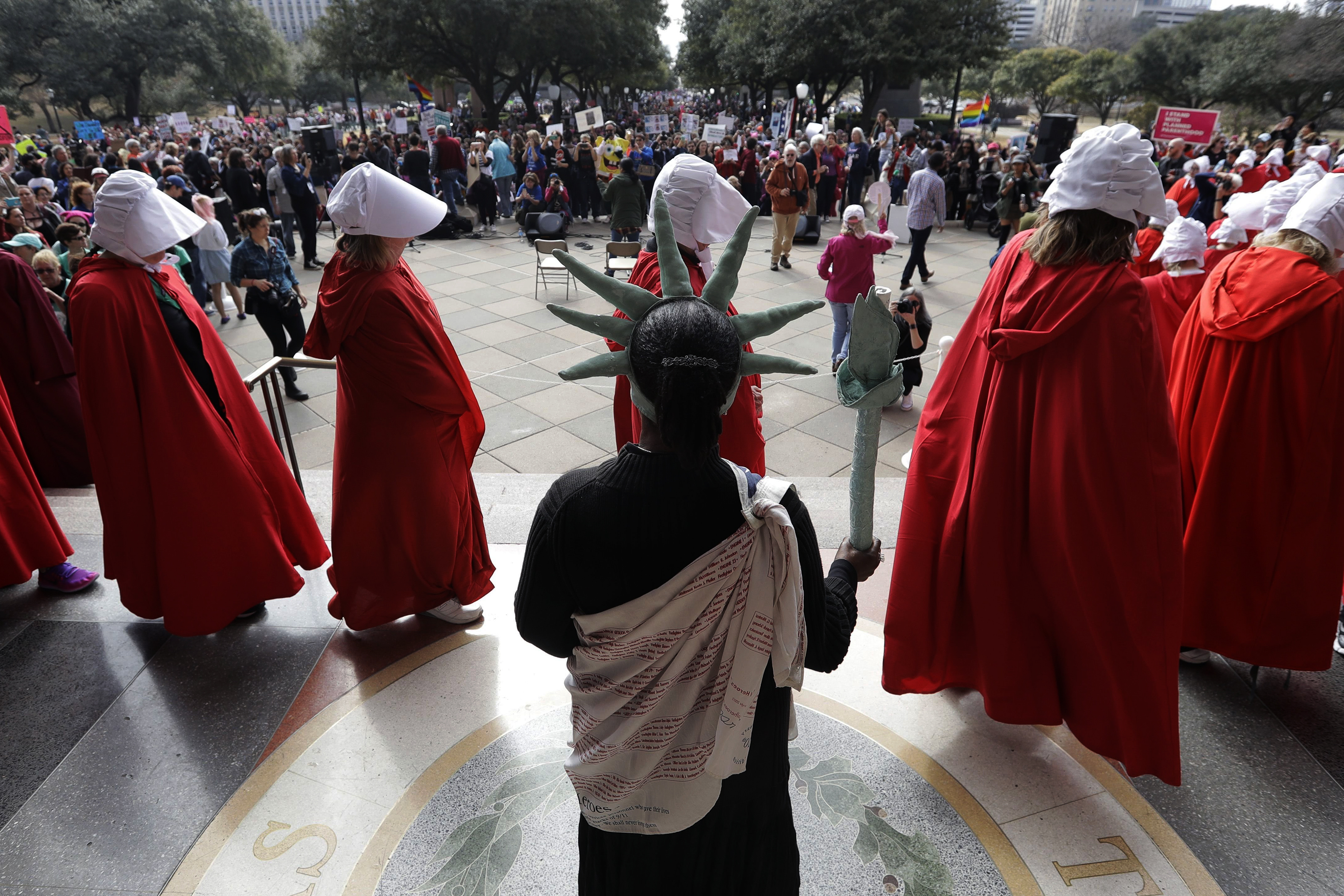 Texas Handmaids at the women's march to the Texas State Capitol in Austin.