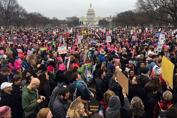 Demonstrators protest on the National Mall in Washington, DC, for the Women's march on January 21, 2017.                     Hundreds of thousands of protesters spearheaded by women's rights groups demonstrated across the U.S. to send a defiant message to US President Donald.