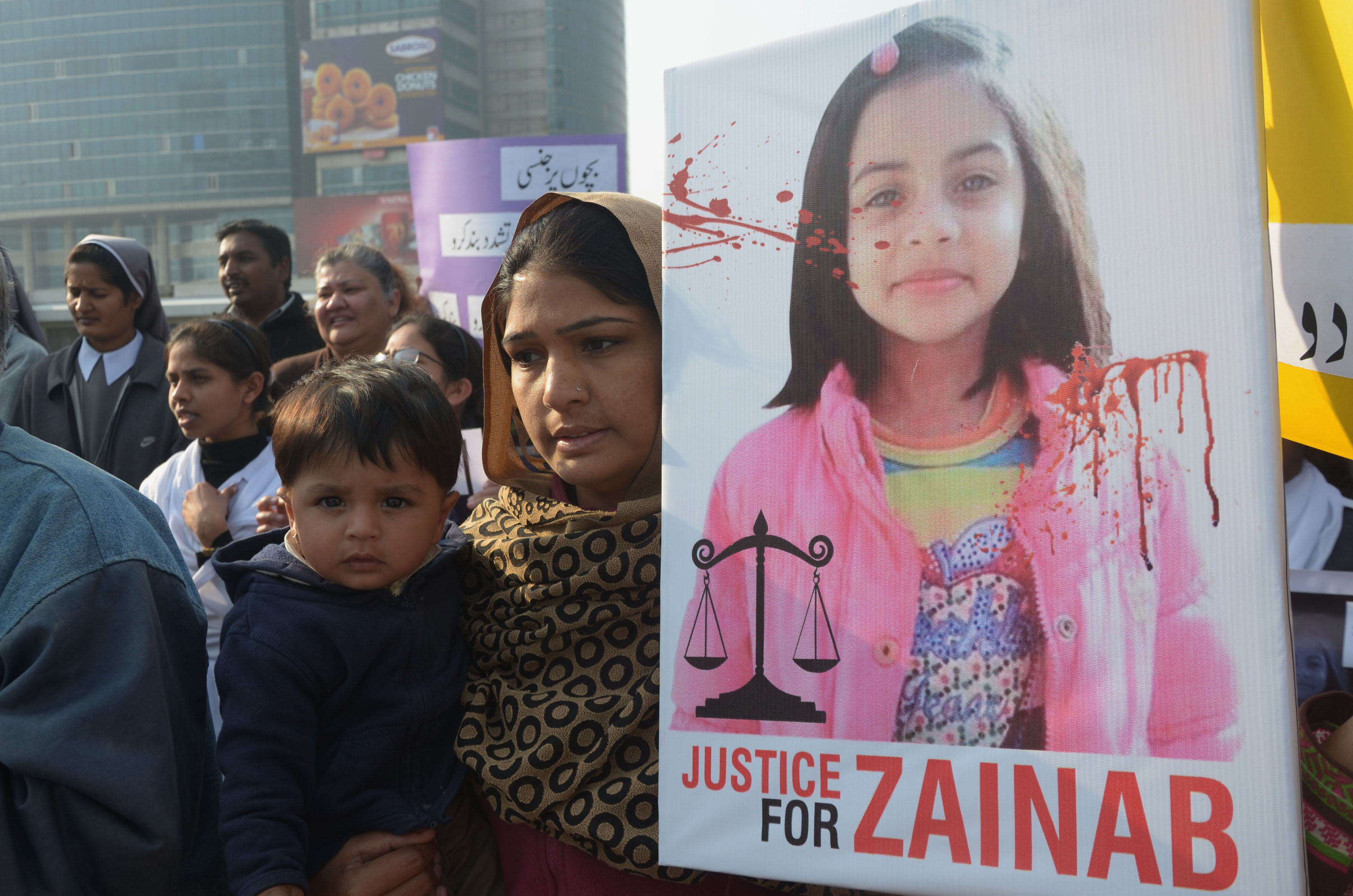 Pakistani Activists of Cecil Chaudhry and Iris Foundation (CCIF) holding placards chant slogans to protest the rape and murder of seven year old Zainab Ansari in Kasur District at Liberty Chowk in Lahore on January 14, 2018. Hundreds of protesters enraged over the murder of a young girl threw stones at government buildings in a Pakistani city near the Indian border for a second day January 11, amid growing outrage over the killing.