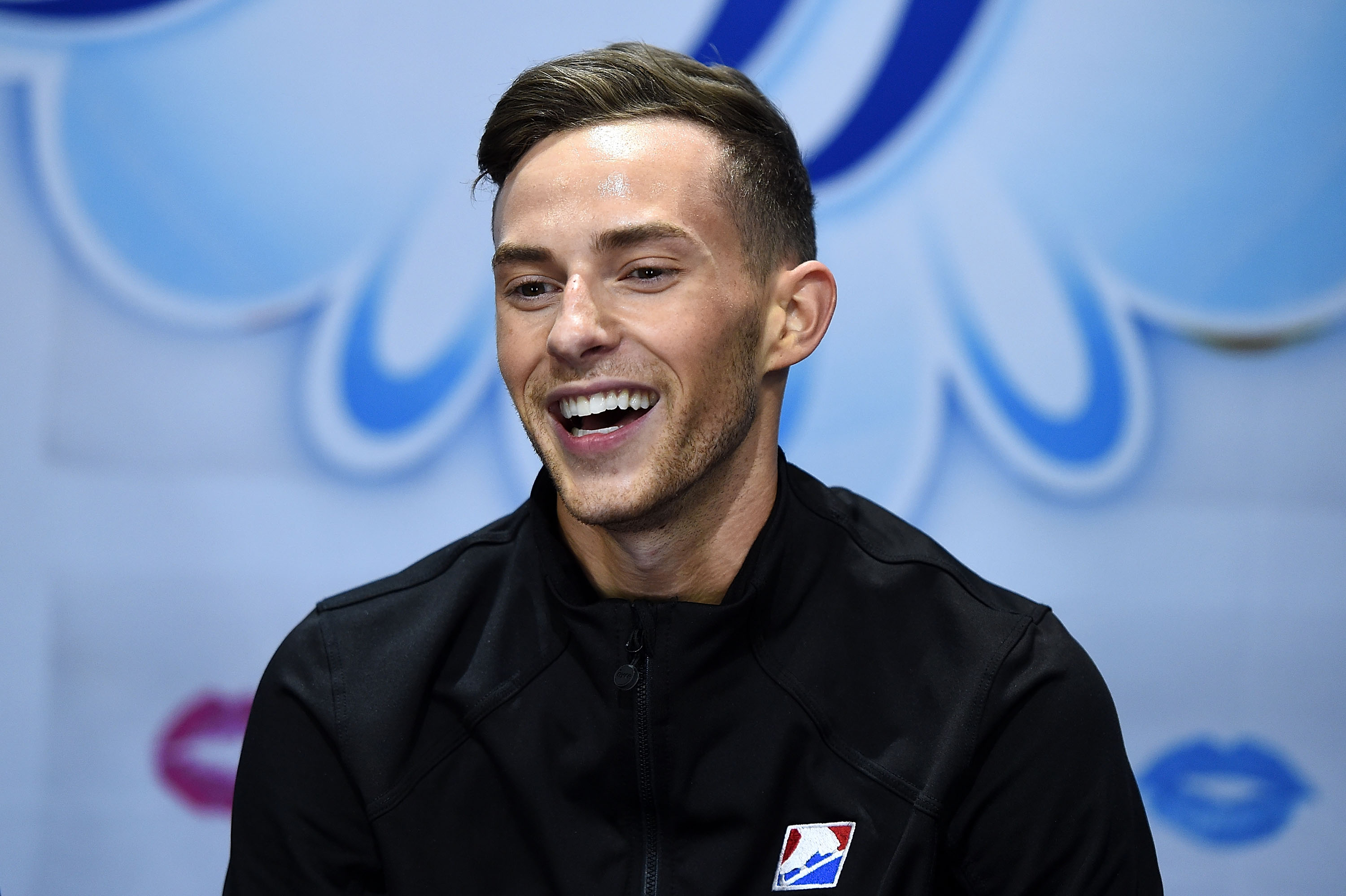 Adam Rippon of the United States waits for his score to be announced on day 2 of the Grand Prix of Skating at the Sears Centre Arena on October 22, 2016 in Chicago, Illinois.