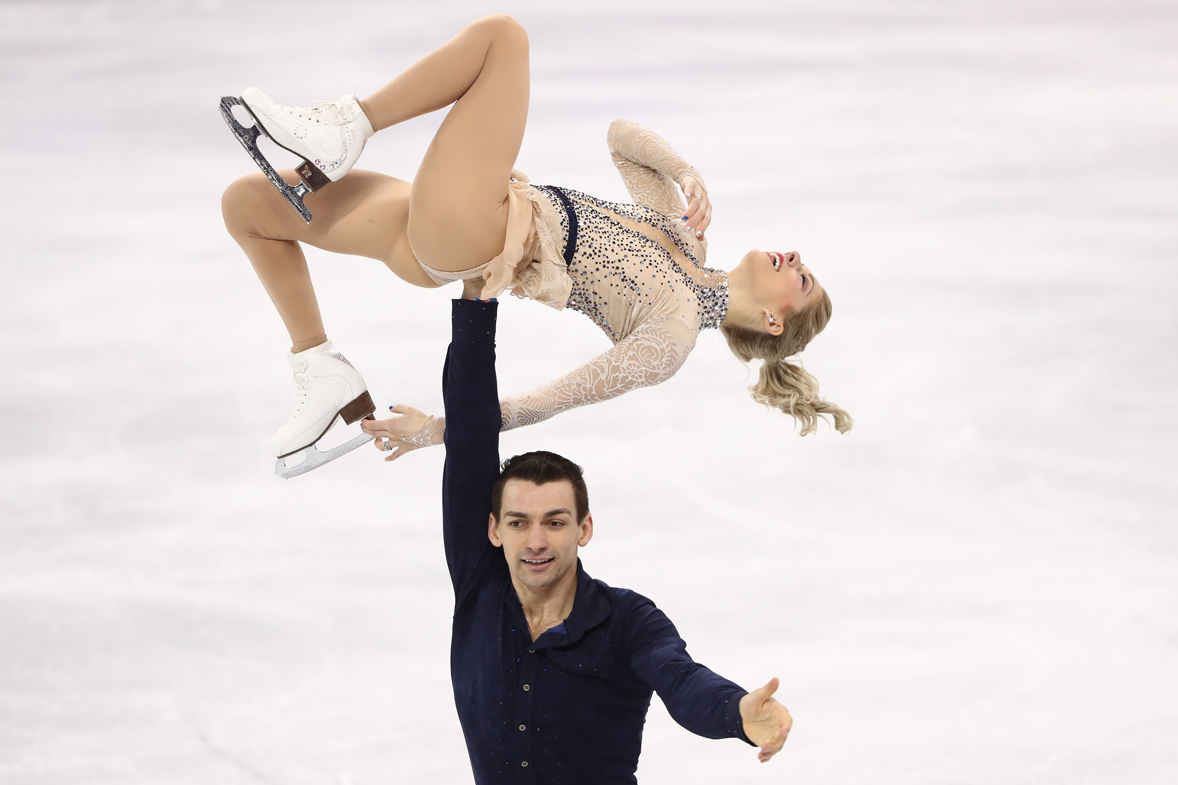 Pair skaters Alexa Scimeca Knierim and Chris Knierim of the USA perform their short program during a figure skating event at the 2018 Winter Olympic Games at Gangneung Ice Arena.