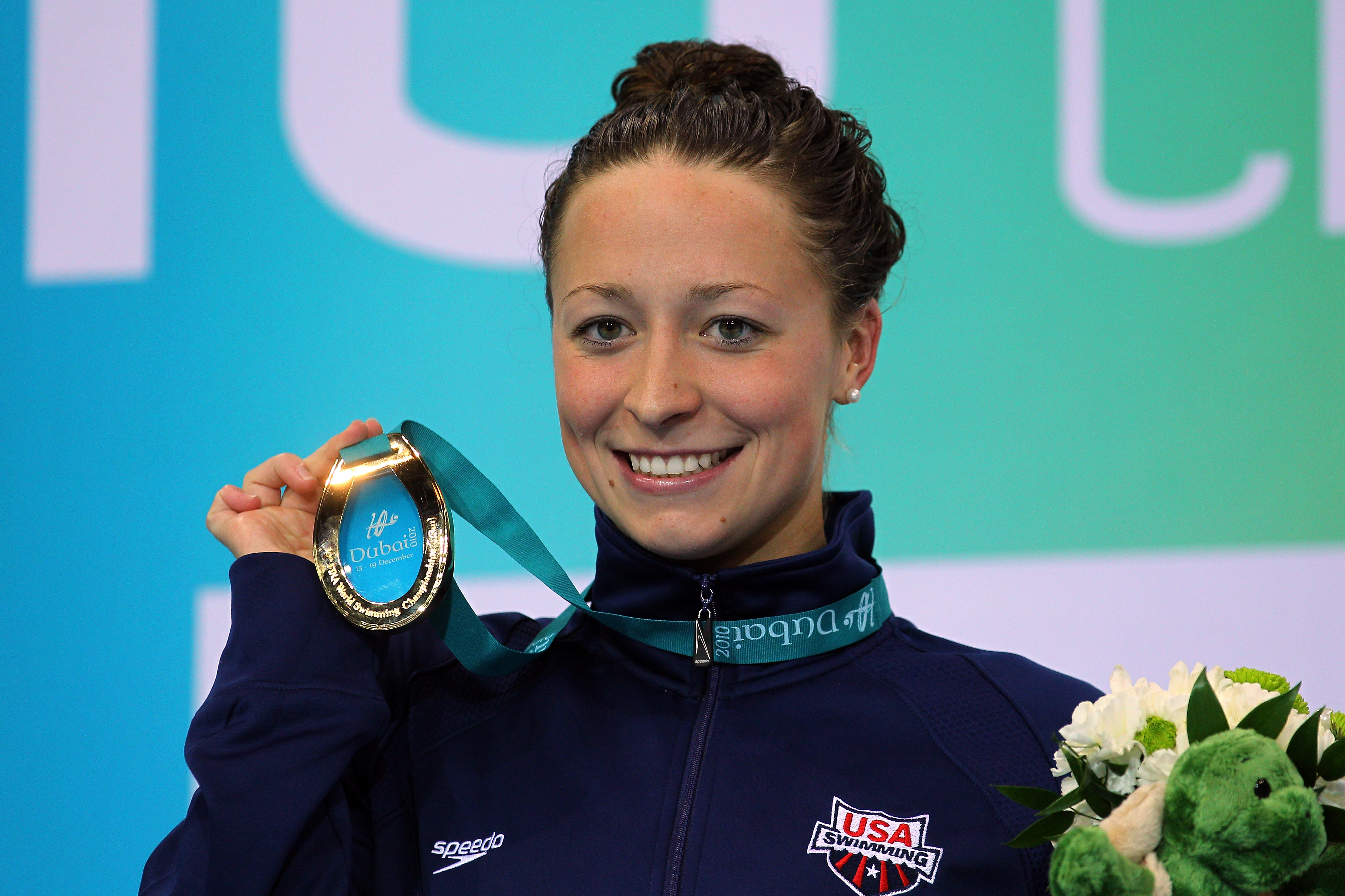 Ariana Kukors poses with her Gold medal after winning the Women's 100m Individual Medley final at the FINA World Swimming Championships.
