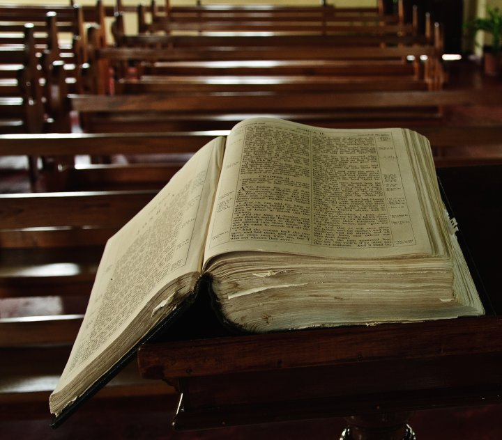 High Angle View Of Bible On Pew At Church