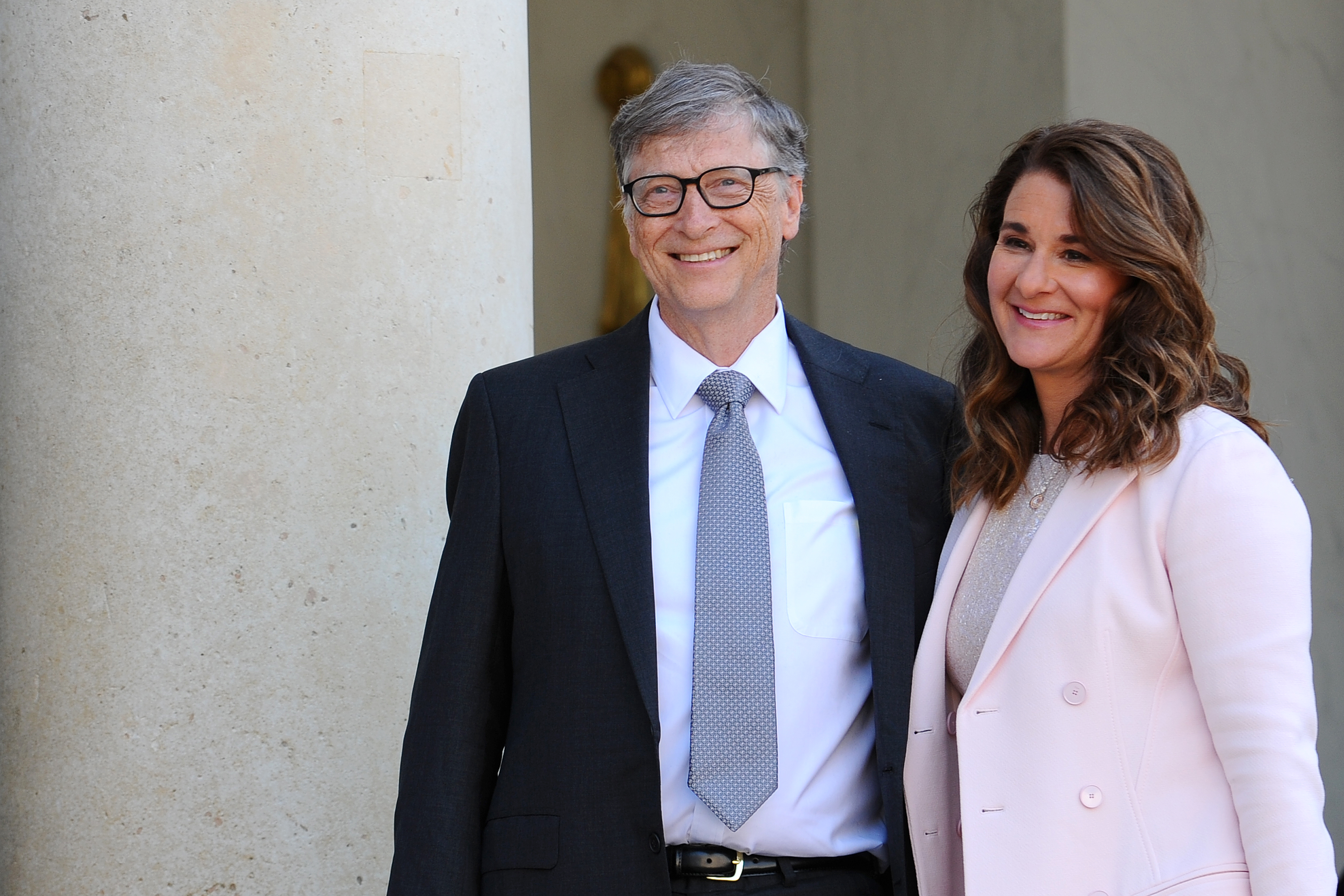 Bill and Melinda Gates pose in front of the Elysee Palace before receiving the award of Commander of the Legion of Honor.