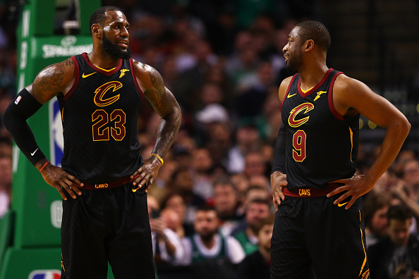 LeBron James #23 of the Cleveland Cavaliers talks with Dwyane Wade #9 during the second half against the Boston Celtics at TD Garden on January 3, 2018 in Boston, Massachusetts.