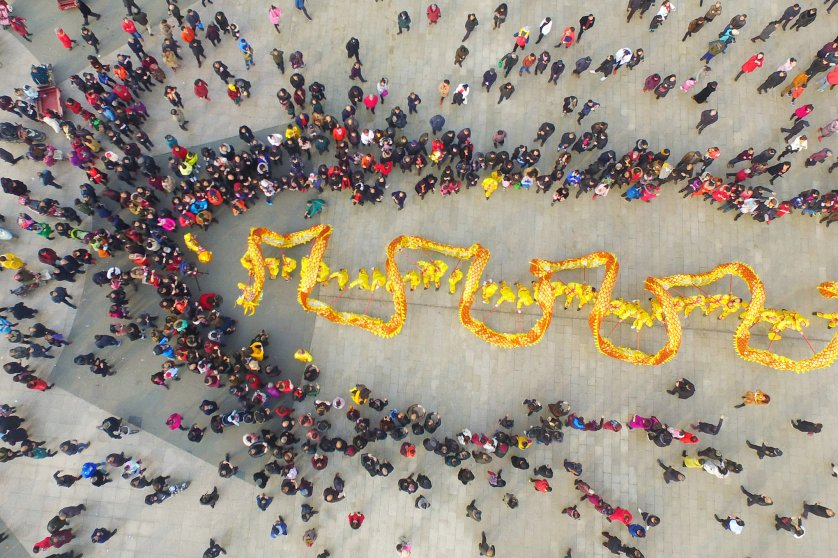 Aerial view of a large crowd watching dragon dance to welcome Lunar New Year on Feb. 16, 2018 in Chengdu, Sichuan Province of China.