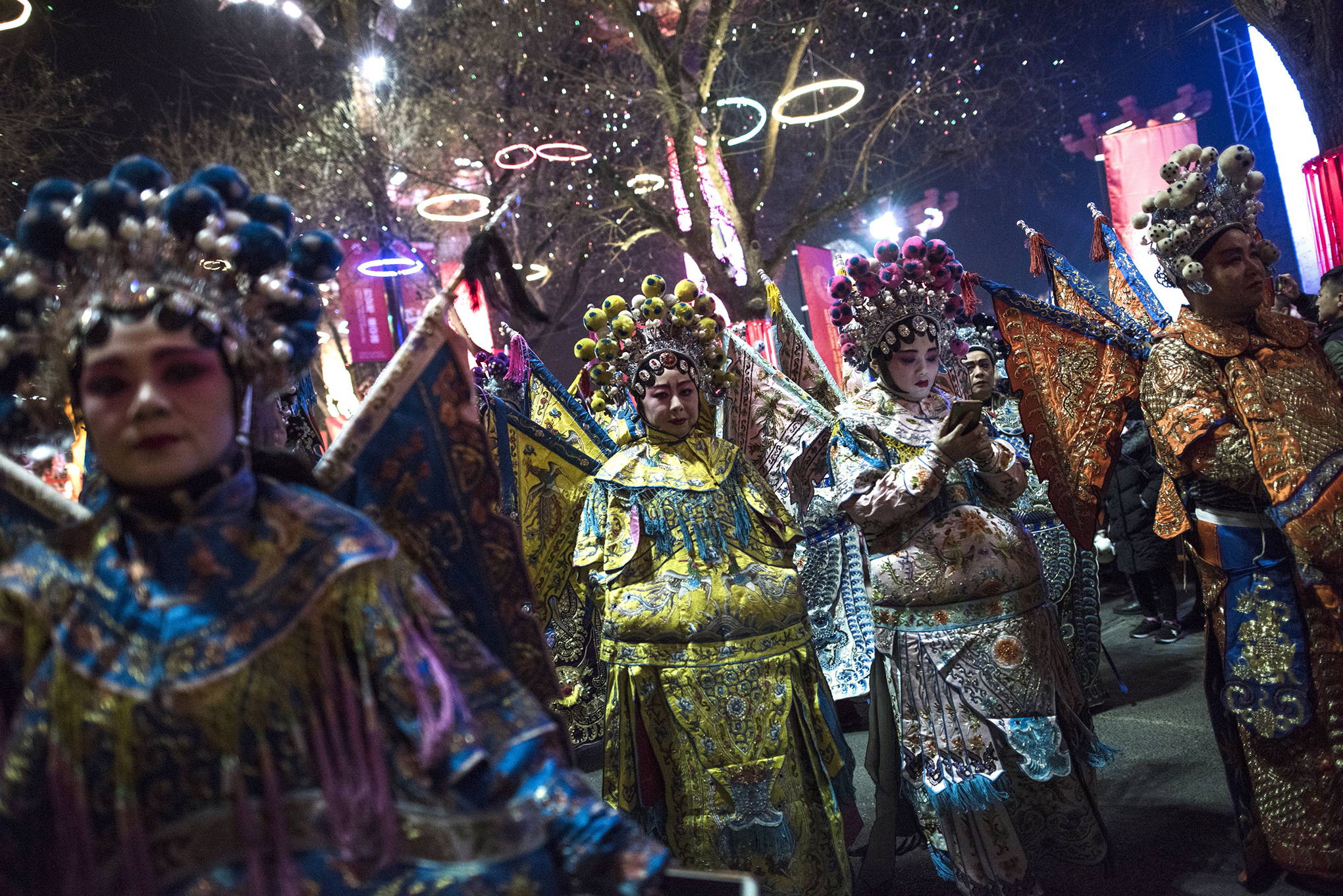 Dancers with traditional Pekin Opera costume, prepare to parade near Tang Paradise park in Xian, Shaanxi province, on Feb. 14, 2018, ahead of the coming Lunar New Year, marking the Year of the Dog.
