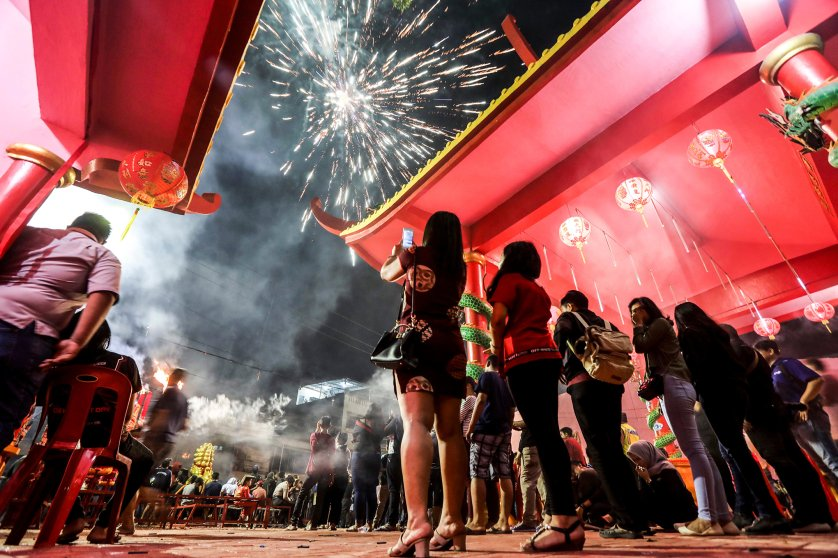 Fireworks light up the sky during the Chinese New Year Eve celebrations at the Pak Pie Hut Cou temple in Medan, North Sumatra, Indonesia, Feb. 16, 2018.