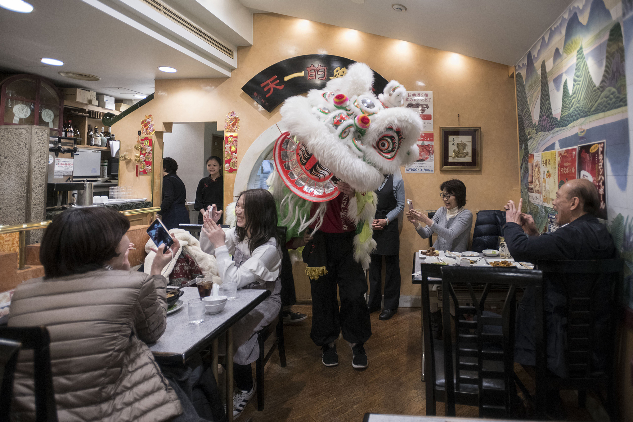 A lion dance is performed inside a restaurant as part of Chinese New Year celebrations in Chinatown, Yokohama, near Tokyo, Feb. 16, 2018.