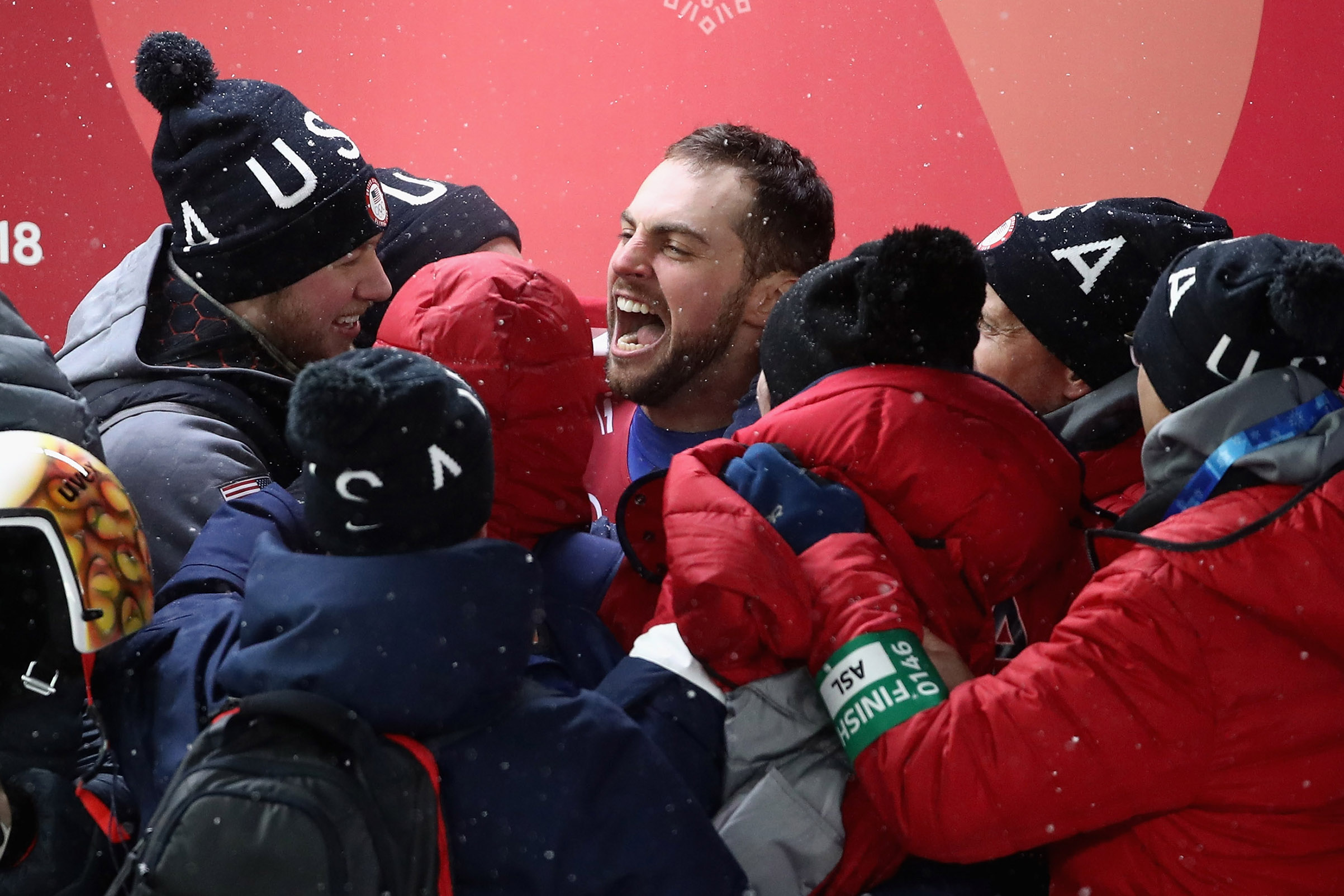 Chris Mazdzer of the United States celebrates after he won silver in the Luge Men's Singles on Feb. 11, 2018.