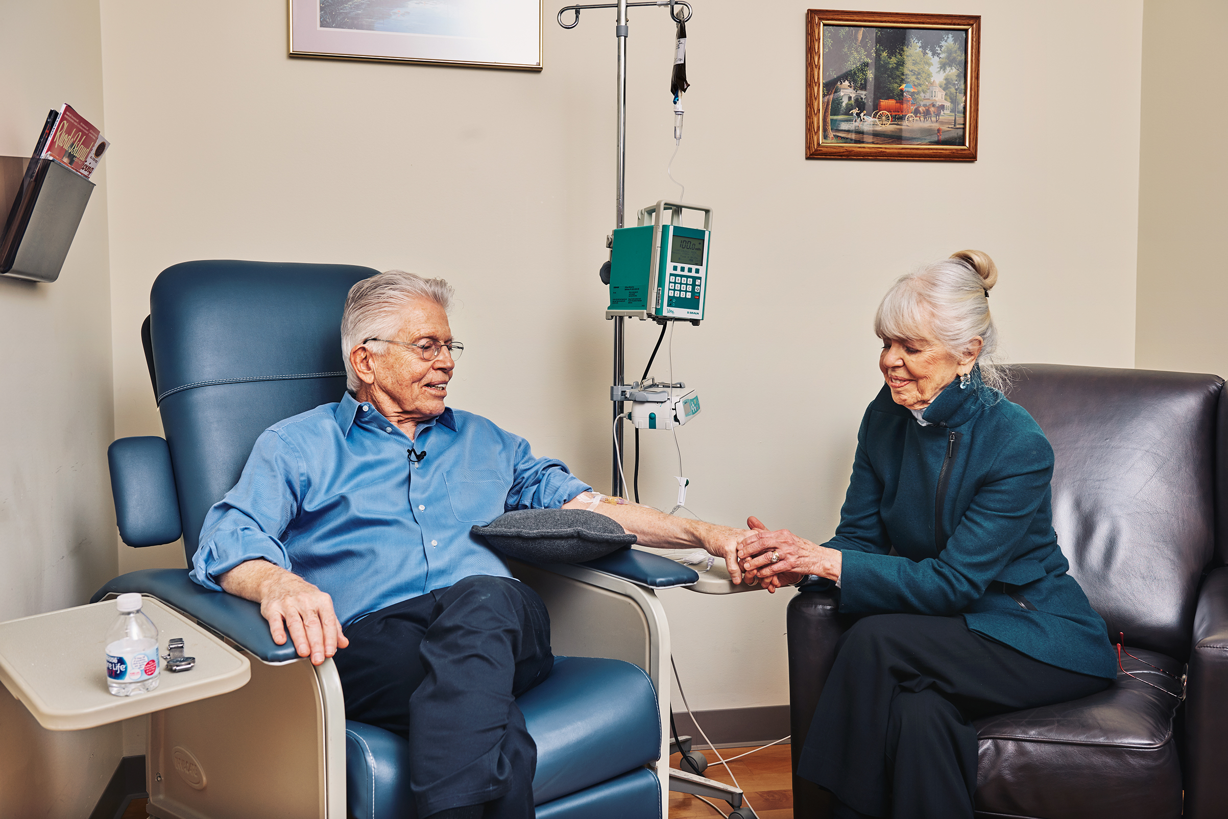 Peter Wooding, with his his wife JoAnn, receiving an infusion of the experimental Alzheimer's drug aducanumab in 2017.