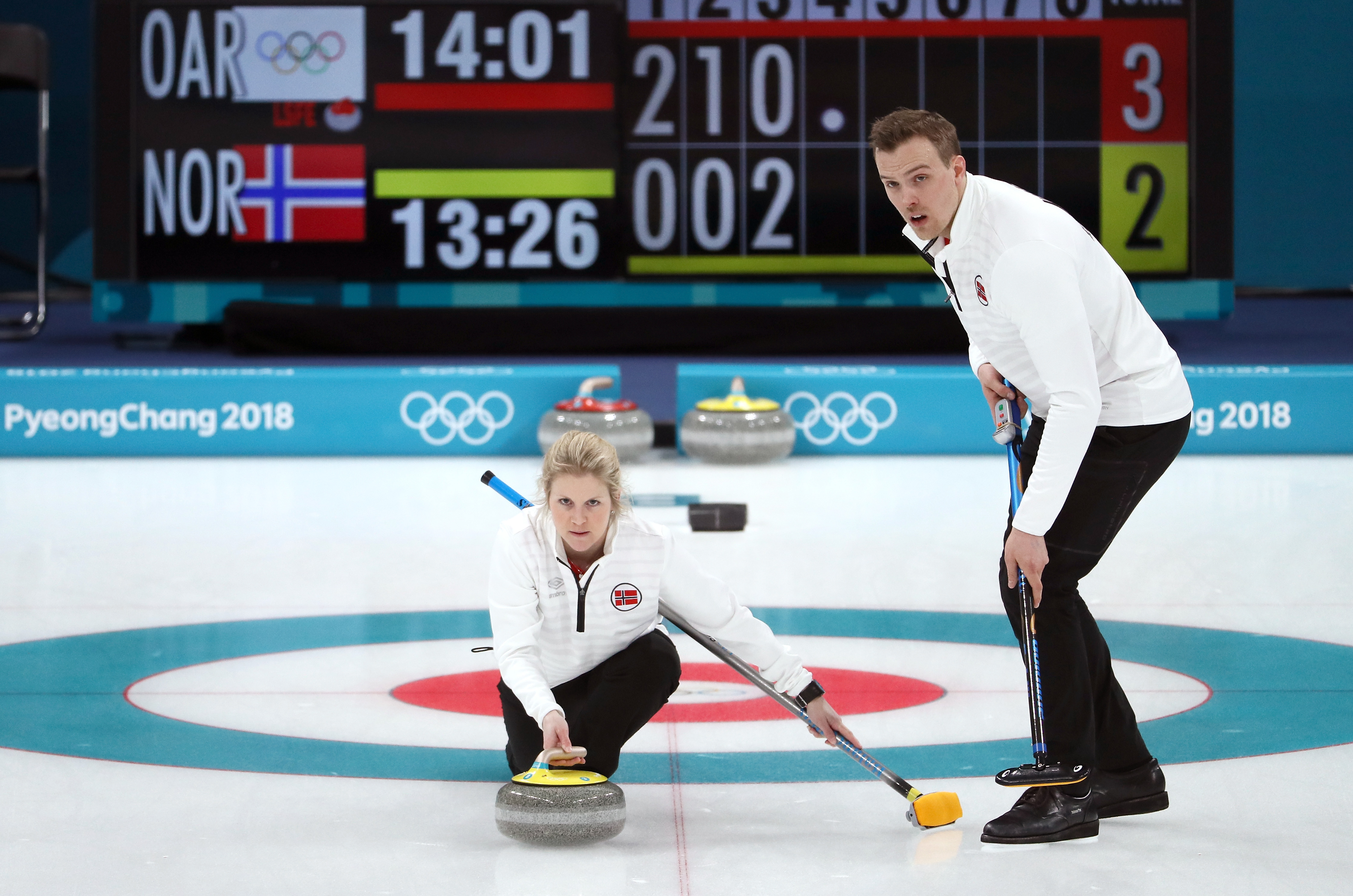 Kristin Skaslien and Magnus Nedregotten of Norway deliver a stone against Olympic Athletes from Russia during the Curling Mixed Doubles Bronze Medal Game on day four of the PyeongChang 2018 Winter Olympic Games at Gangneung Curling Centre on February 13, 2018 in Gangneung, South Korea.
