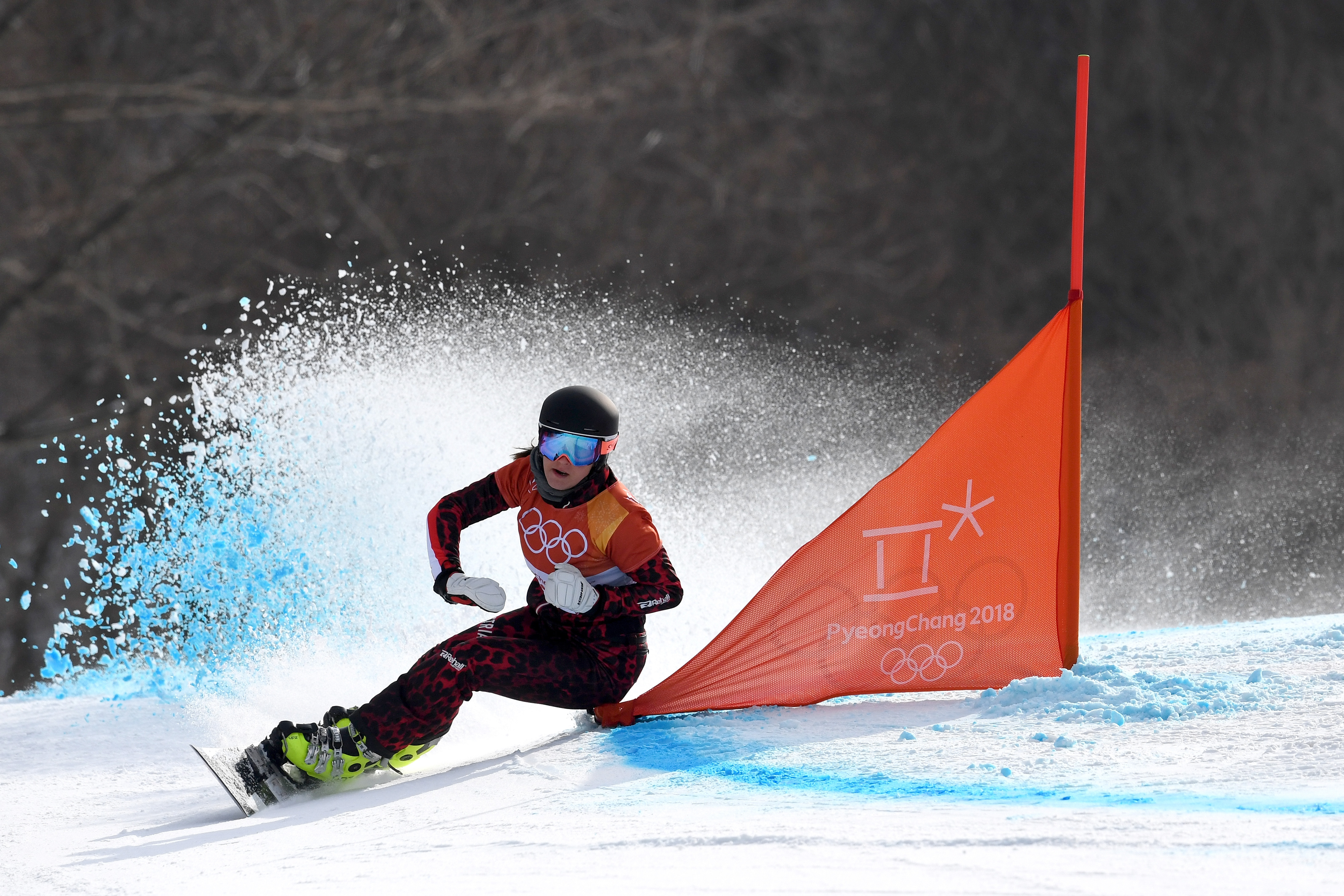 PYEONGCHANG-GUN, SOUTH KOREA - FEBRUARY 24:  Daniela Ulbing of Austria competes during the Ladies' Snowboard Parallel Giant Slalom 1/8 Final on day fifteen of the PyeongChang 2018 Winter Olympic Games at Phoenix Snow Park on February 24, 2018 in Pyeongchang-gun, South Korea.  (Photo by David Ramos/Getty Images)