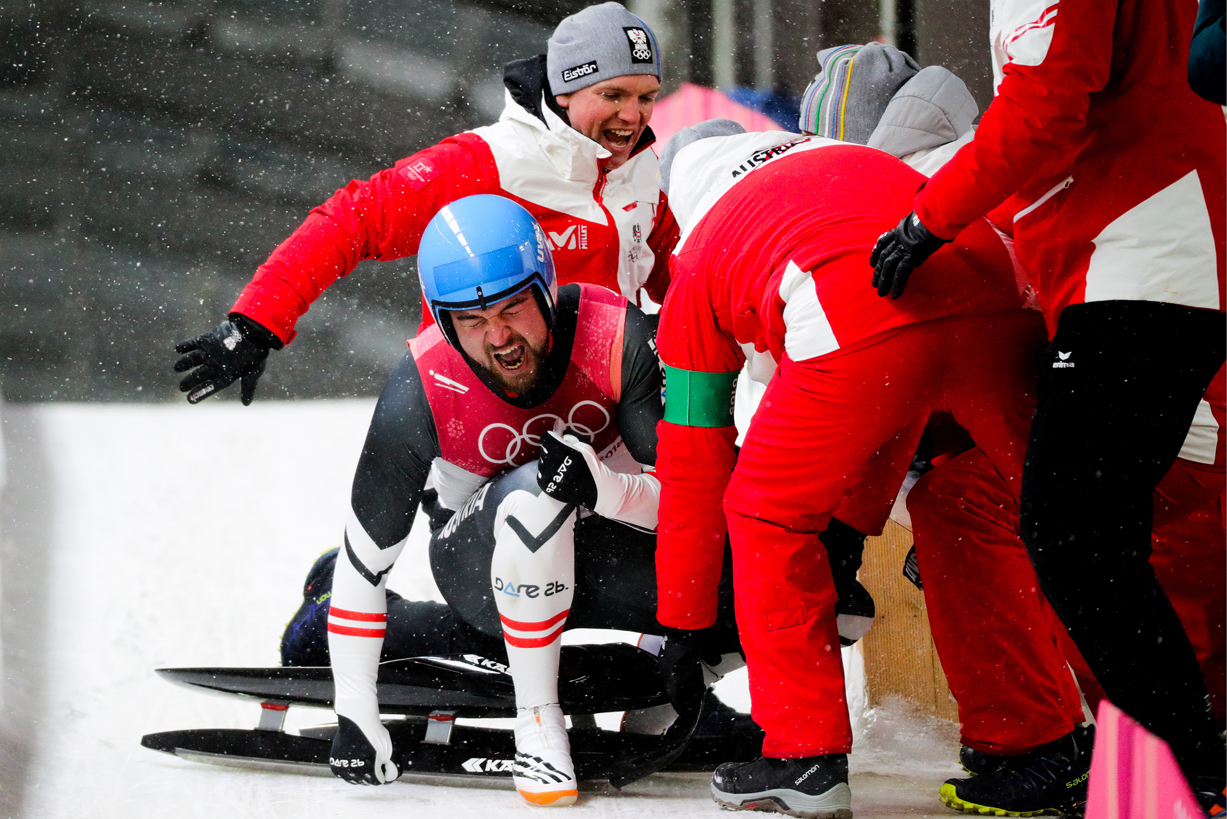 Luger David Gleirscher of Austria reacts as he wins the men's singles luge event.