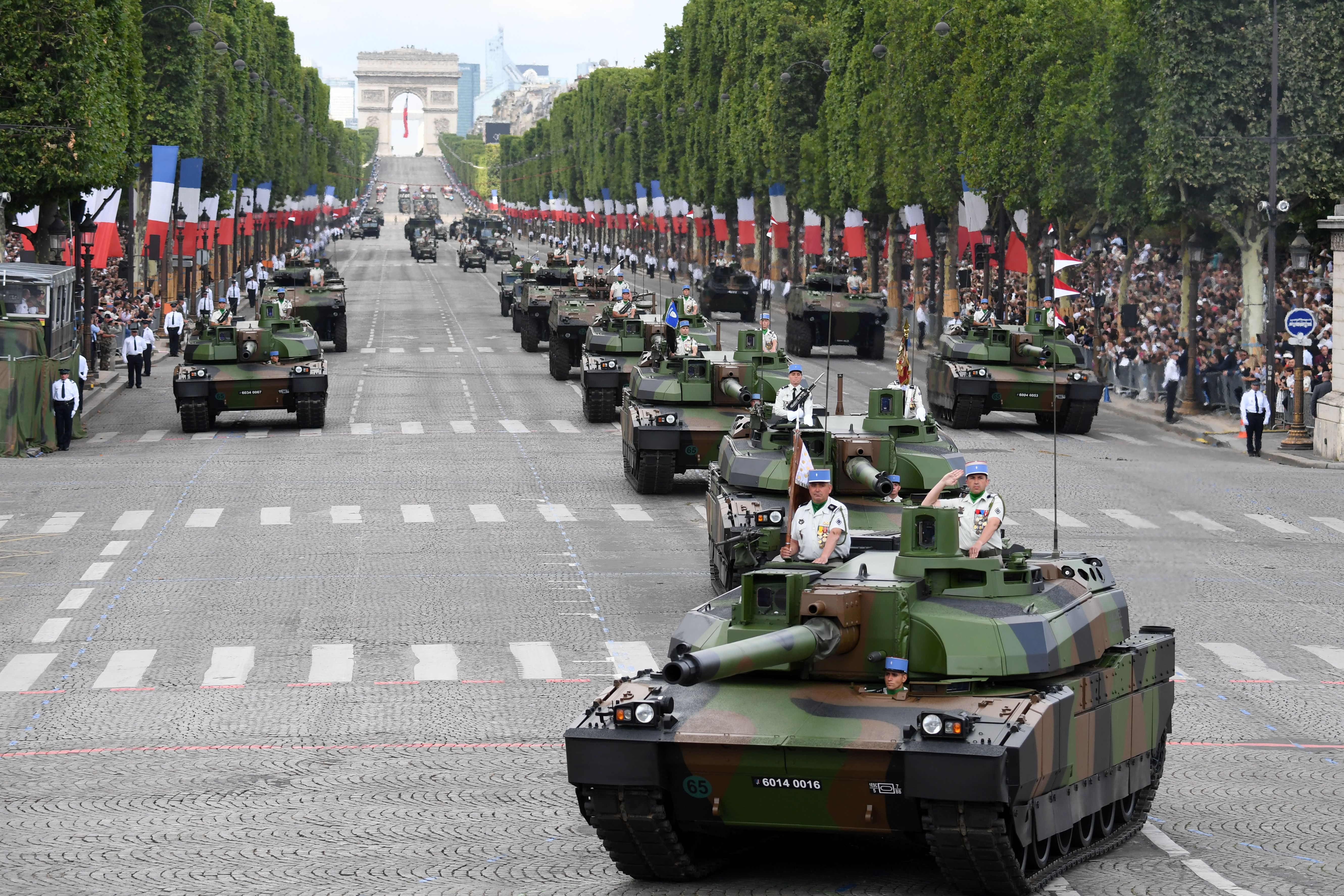 Members of the 5e Regiment de Dragons (5th Dragoon Regiment) parade on Leclerc tanks during the annual Bastille Day military parade on the Champs-Elysees avenue in Paris on July 14, 2017.