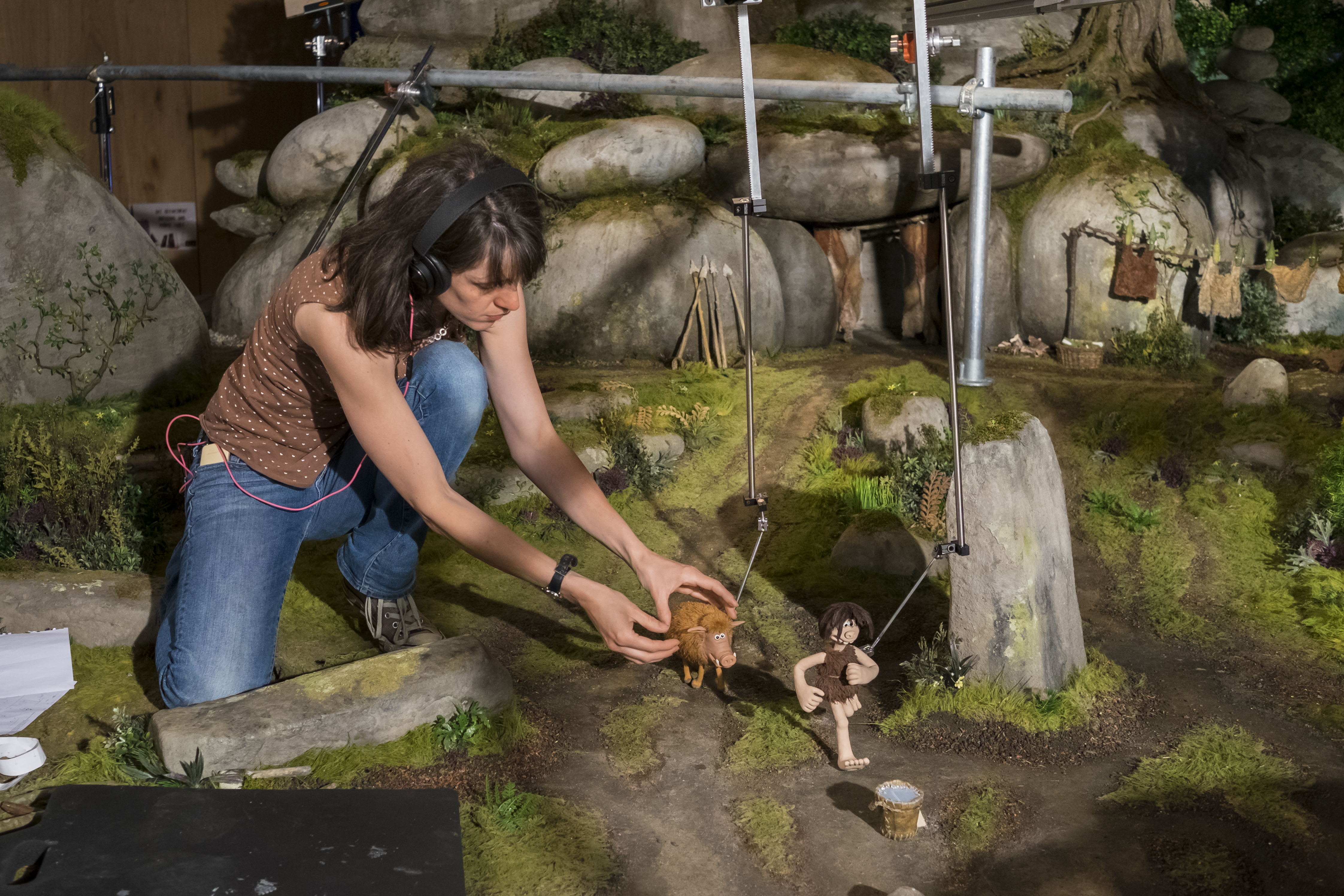 Animator, Claire Rolls with Dug and Hognob on set. The rig being used was removed in post production.