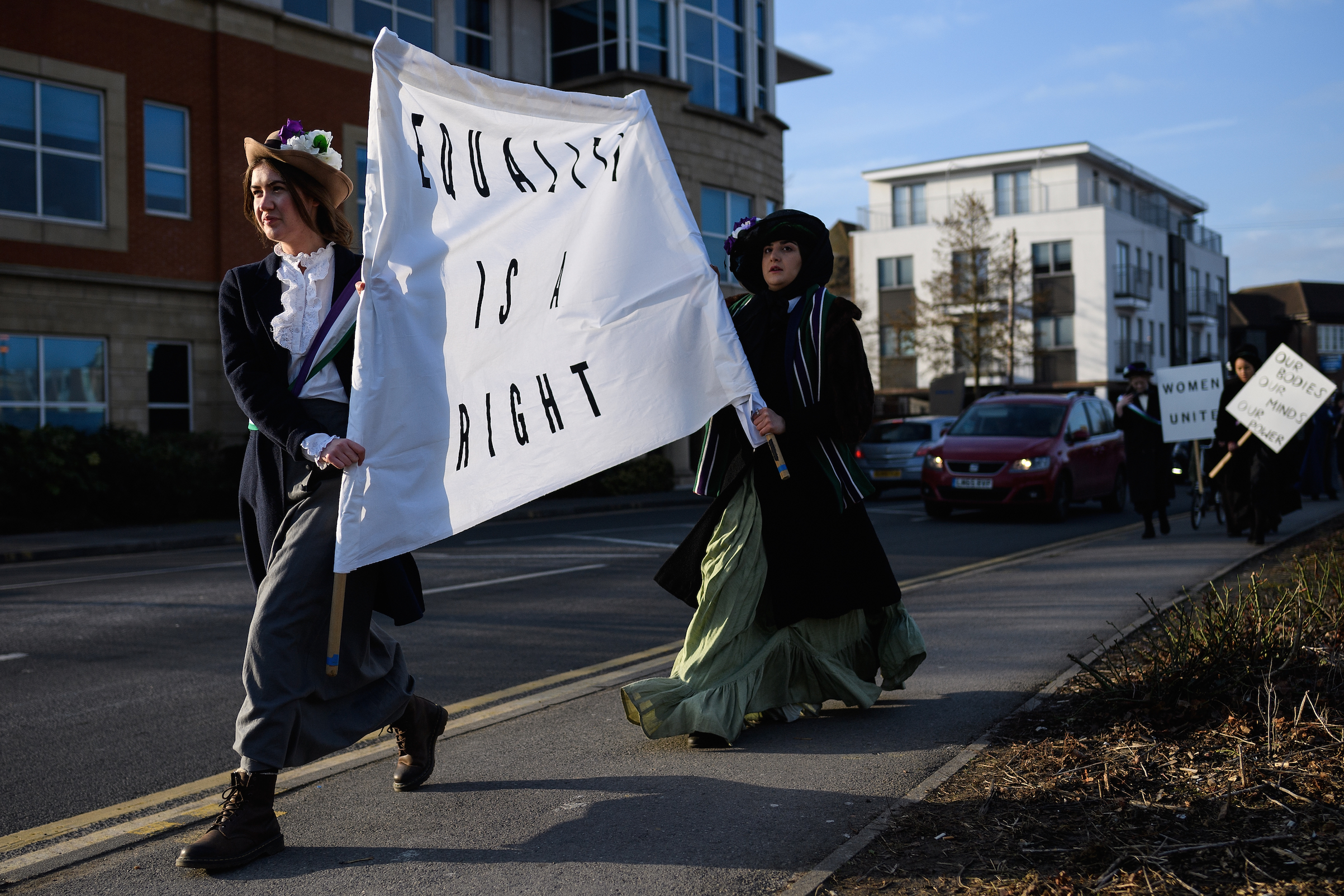 Students recreate a suffragette protest march through the town center at Royal Holloway, University of London on Feb. 6, 2018 in Egham, England.