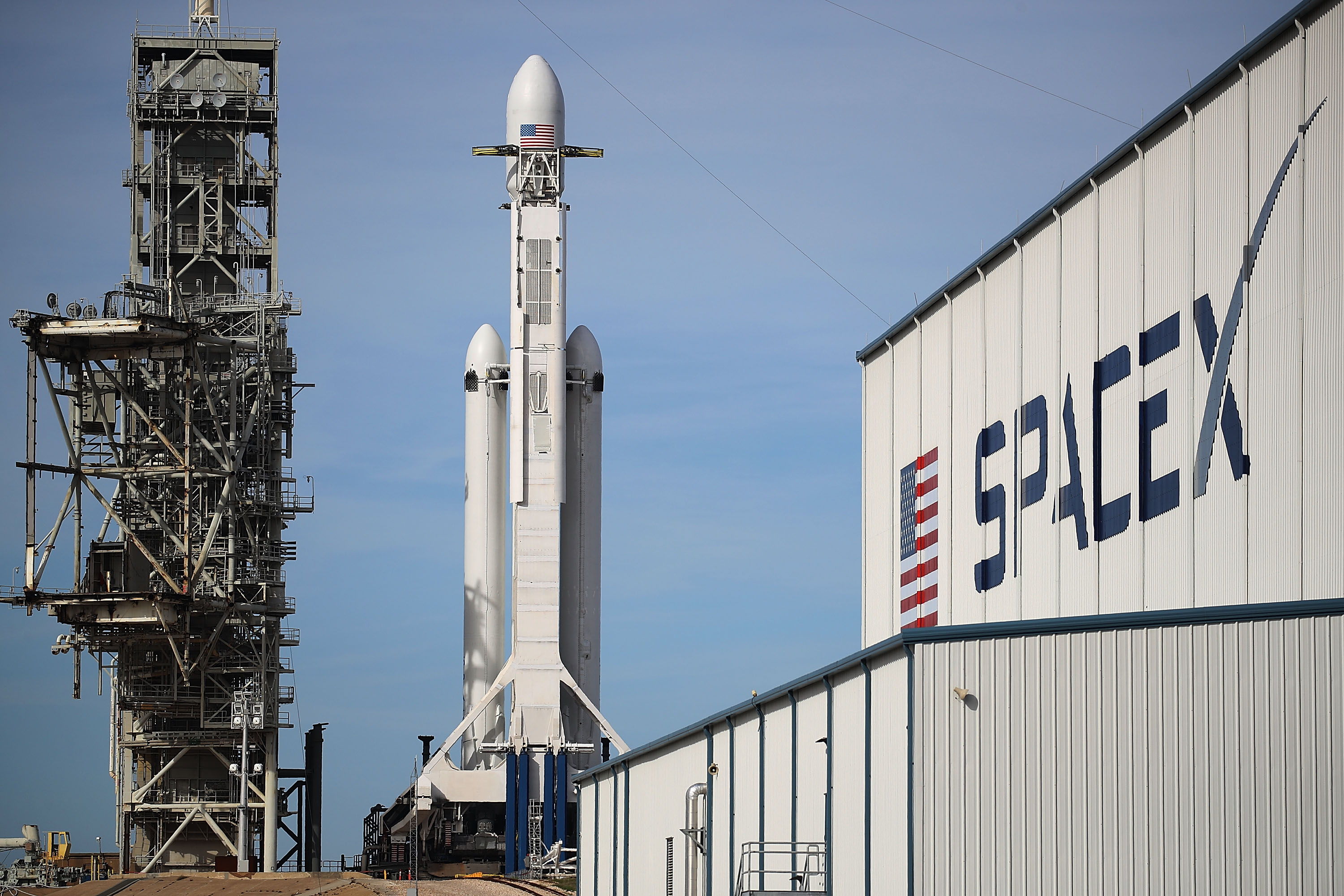 The SpaceX Falcon Heavy rocket sits on launch pad 39A at Kennedy Space Center as it is prepared for tomorrow's lift-off  on February 5, 2018 in Cape Canaveral, Florida.