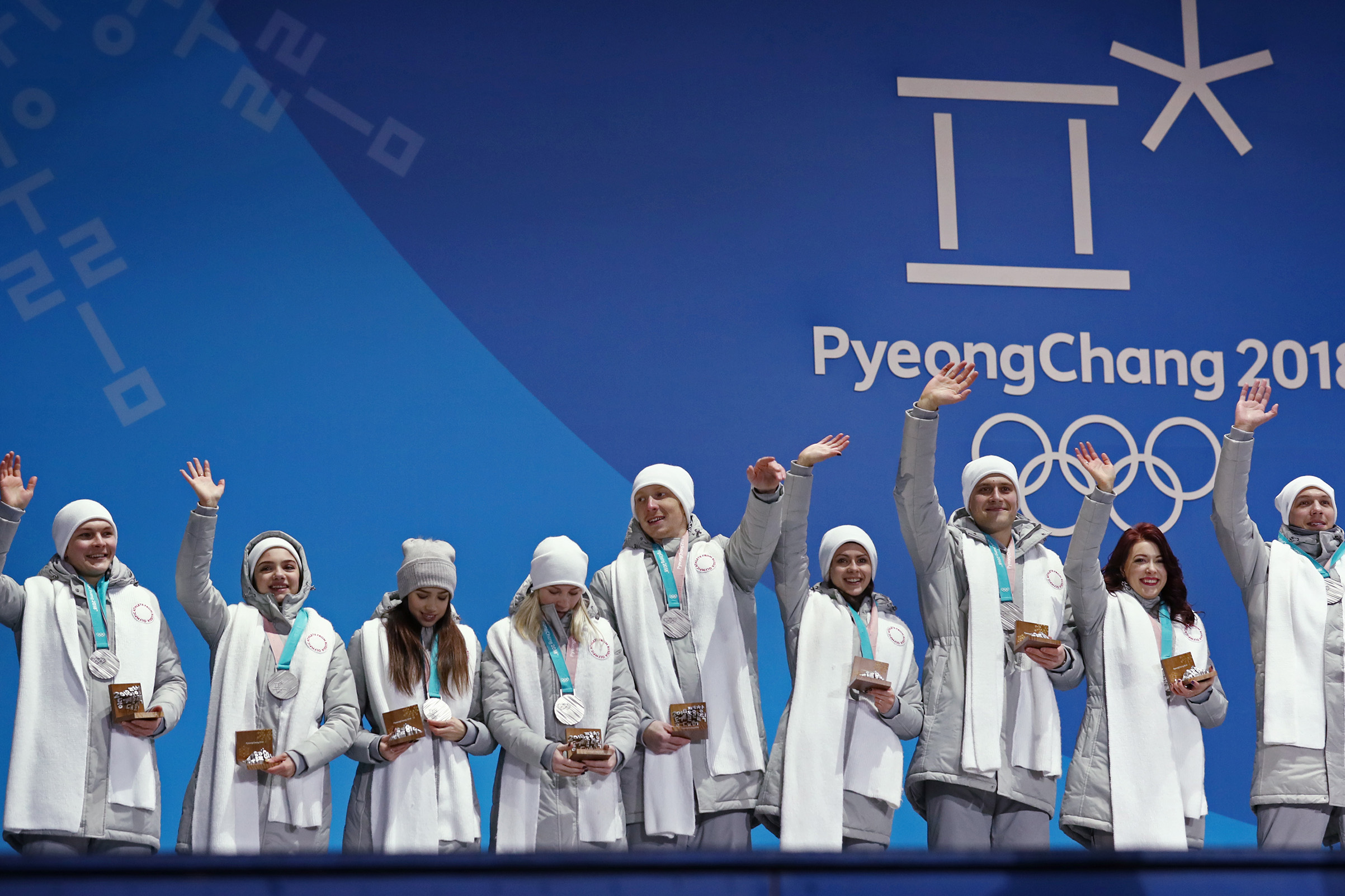 Olympic Athletes from Russia Mikhail Kolyada, Evgenia Medvedeva, Alina Zagitova, Yevgenia Tarasova, Vladimir Morozov, Natalya Zabiyako, Alexander Enbert, Ekaterina Bobrova, and Dmitri Soloviev (L-R) pose with their silver medals during the victory ceremony for the figure skating team event.