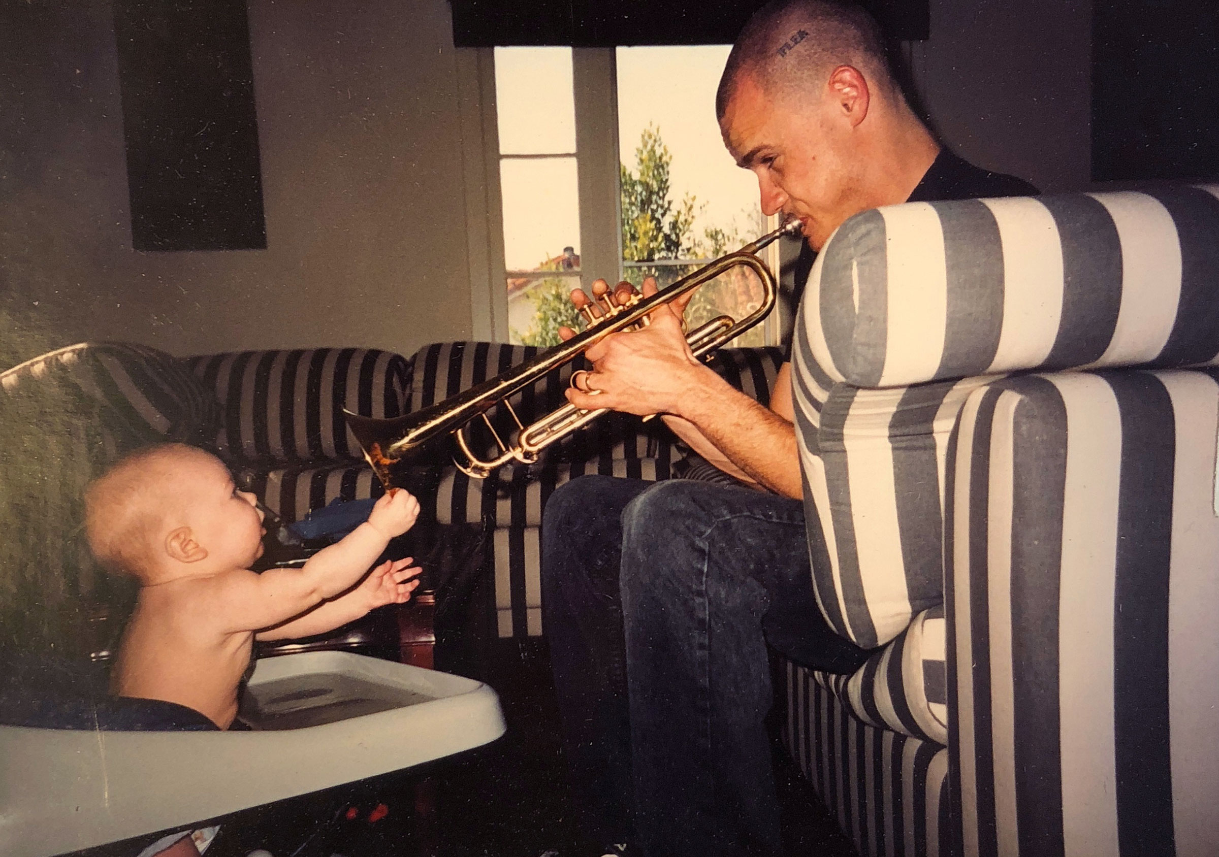 Flea at age 26 with his one year old daughter, Clara Balzary.