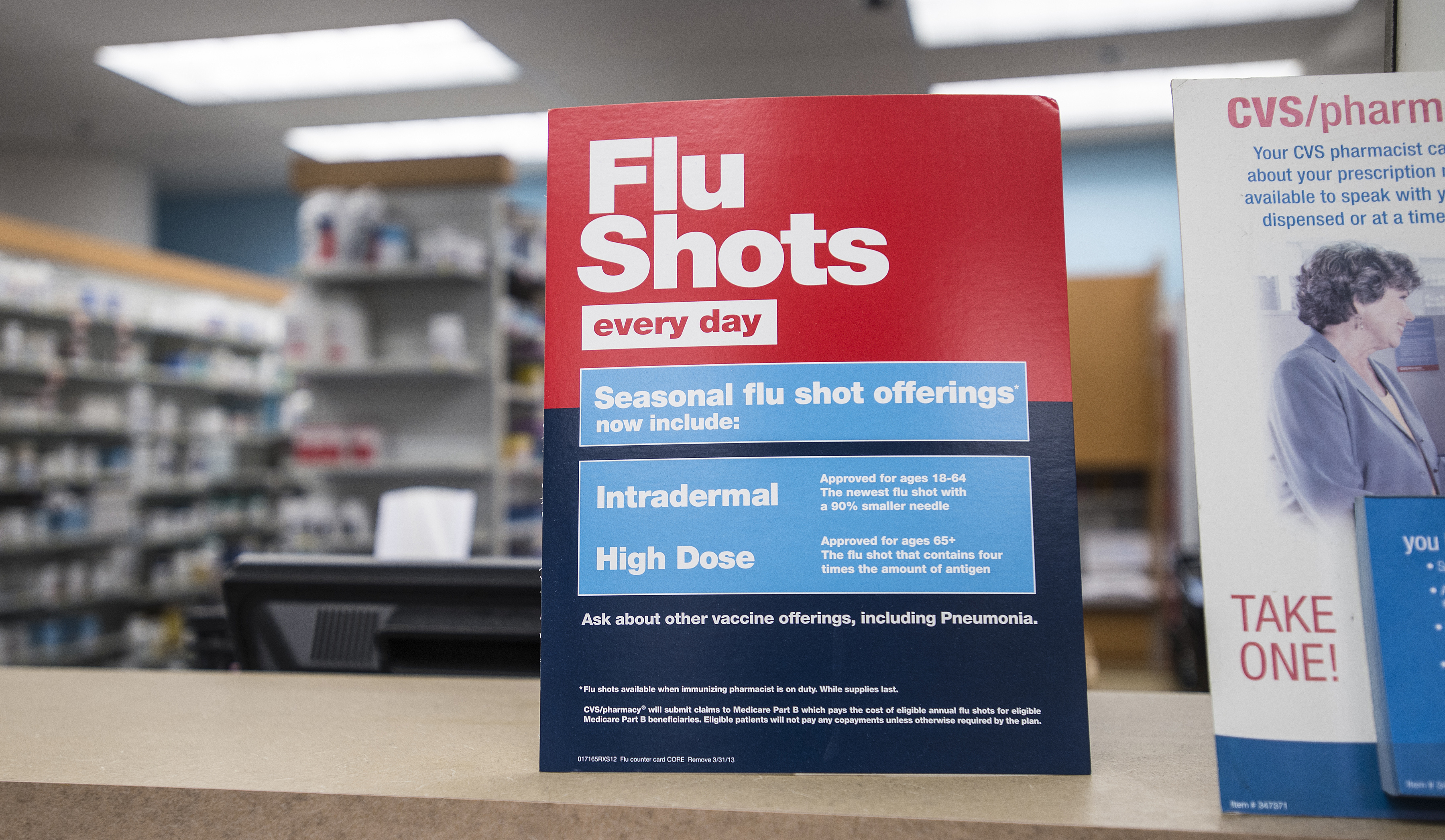 A sign for flu shots at a CVS Pharmacy in Boston.