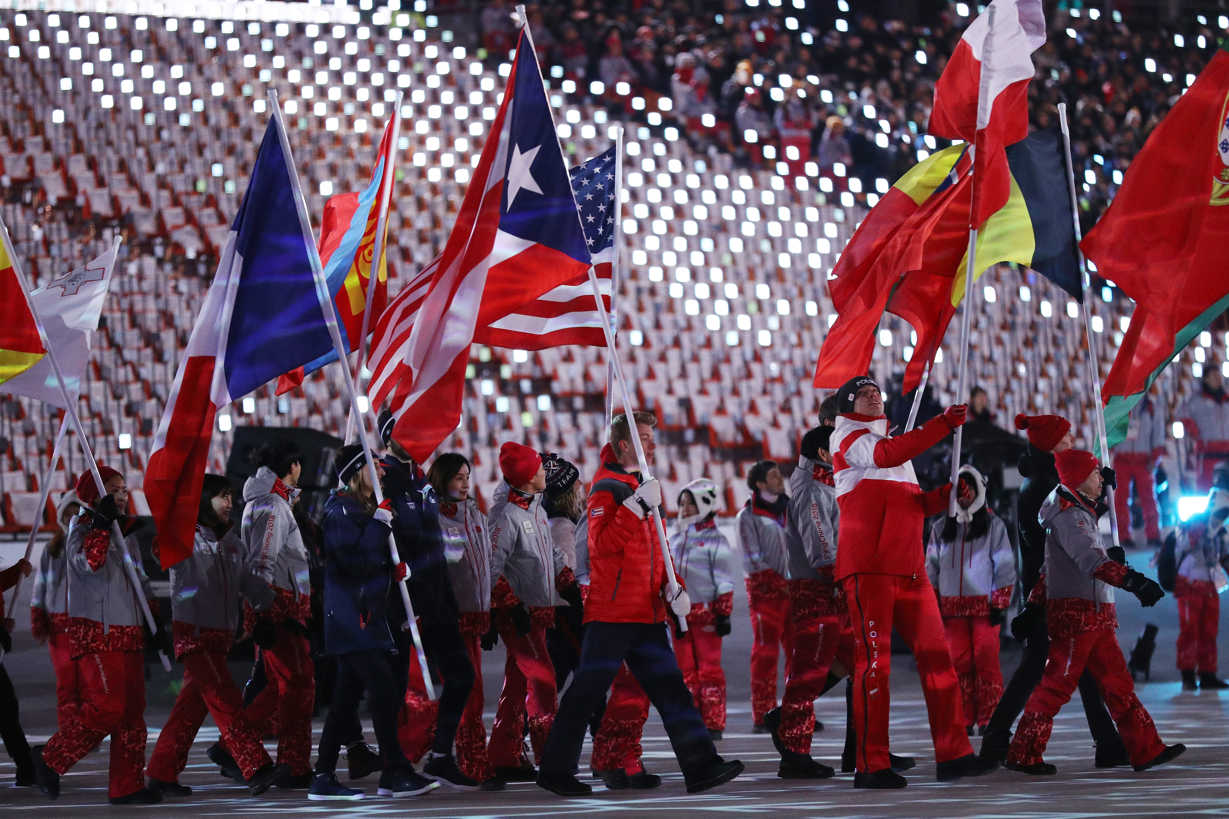 Flag bearer Gabriella Papadakis of France walks in the Parade of Athletes during the Closing Ceremony of the PyeongChang 2018 Winter Olympic Games.