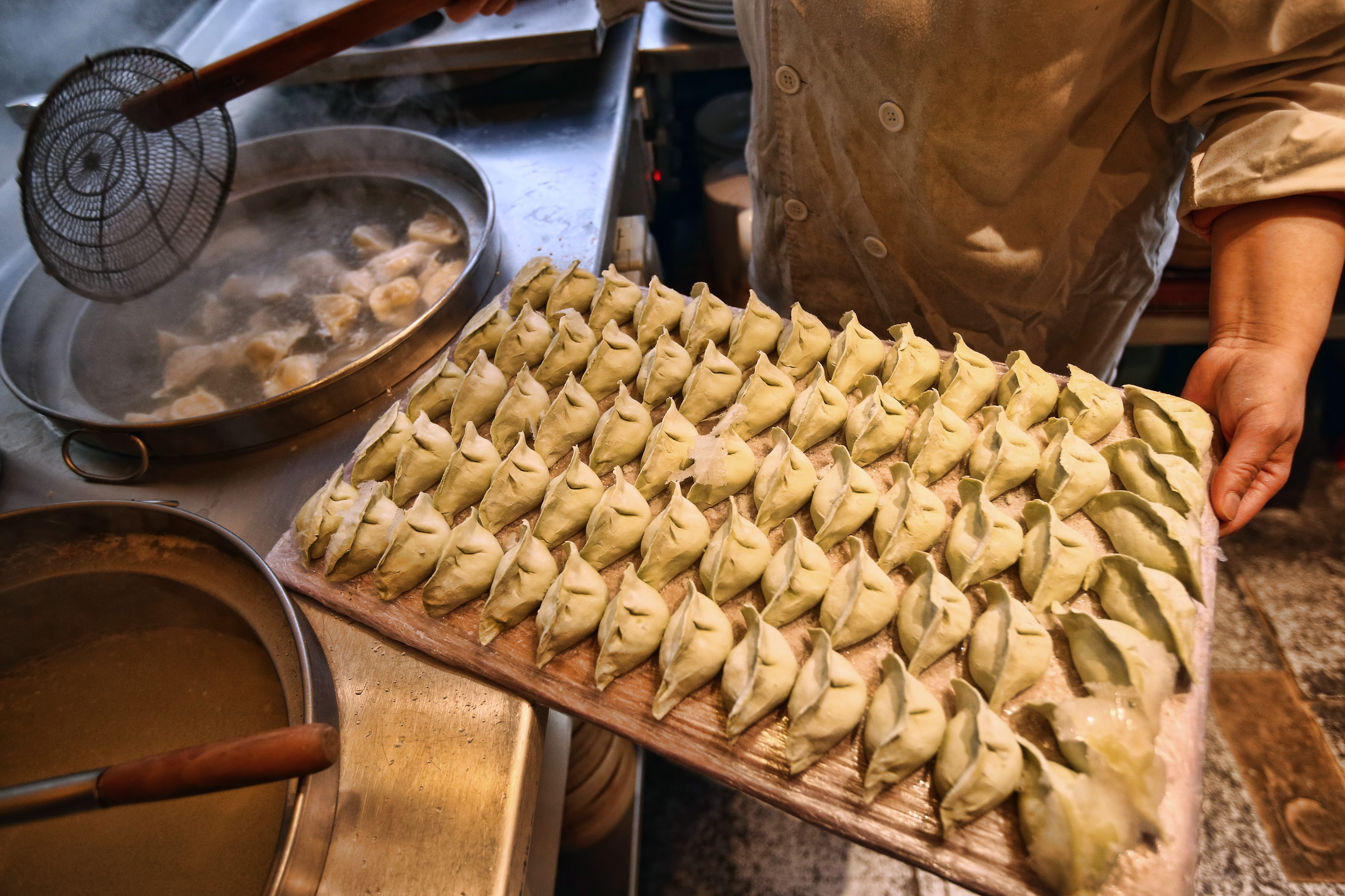 A chef prepares dumplings in a restaurant in China Town on Feb. 18, 2015 in London, England. Carl Court—Getty Images