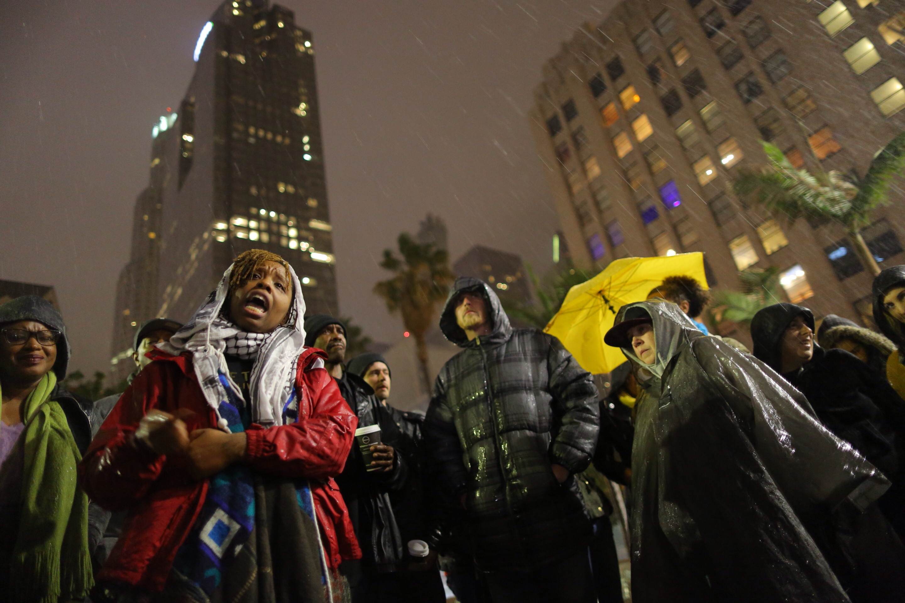 Patrisse Cullors speaks to the people gathered at Pershing Square in Los Angeles to protest a homeless man who was shot during a confrontation downtown by the LAPD, March 1, 2015